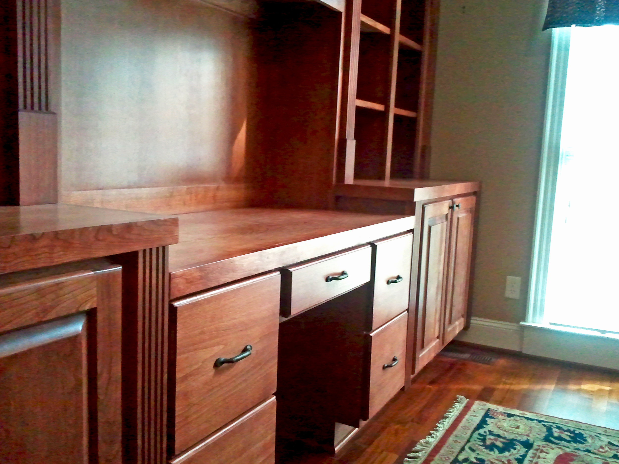 Cherry Desk with Fluting Detail, Raised Panel Doors, Filing Drawers & Pen Drawer