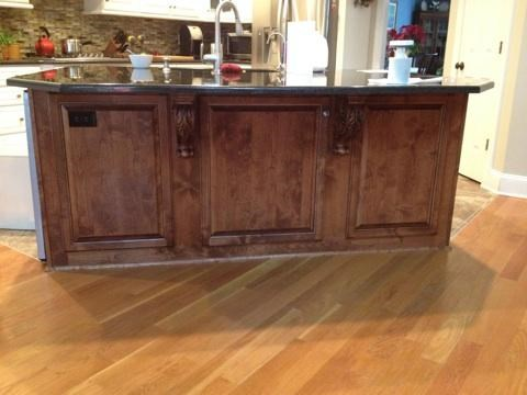 Custom Stained Island with Raised Panel Detail & Corbels