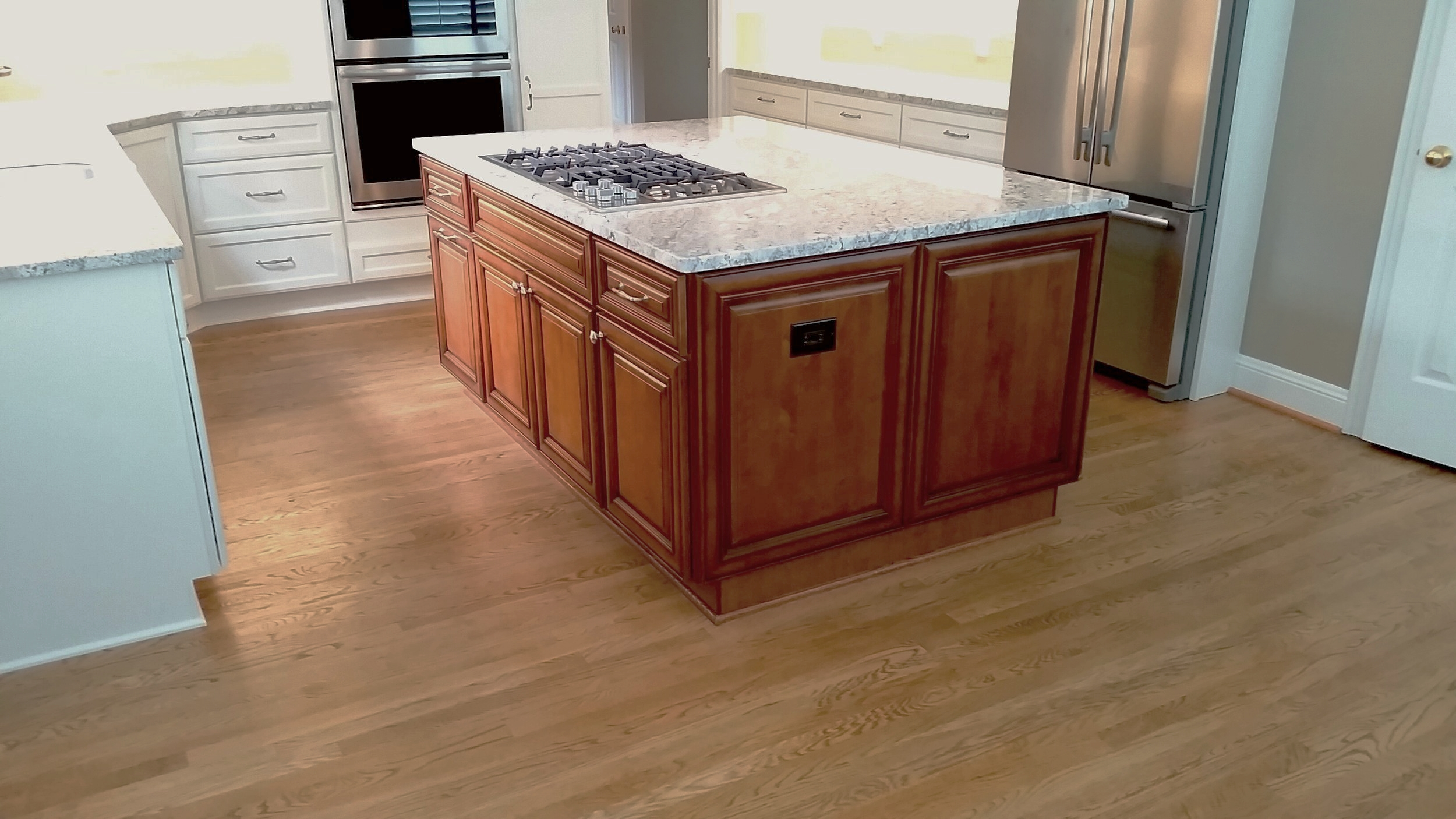 Custom Stained Island with Cooktop, Raised Panel Doors, Drawers, and End-Panels