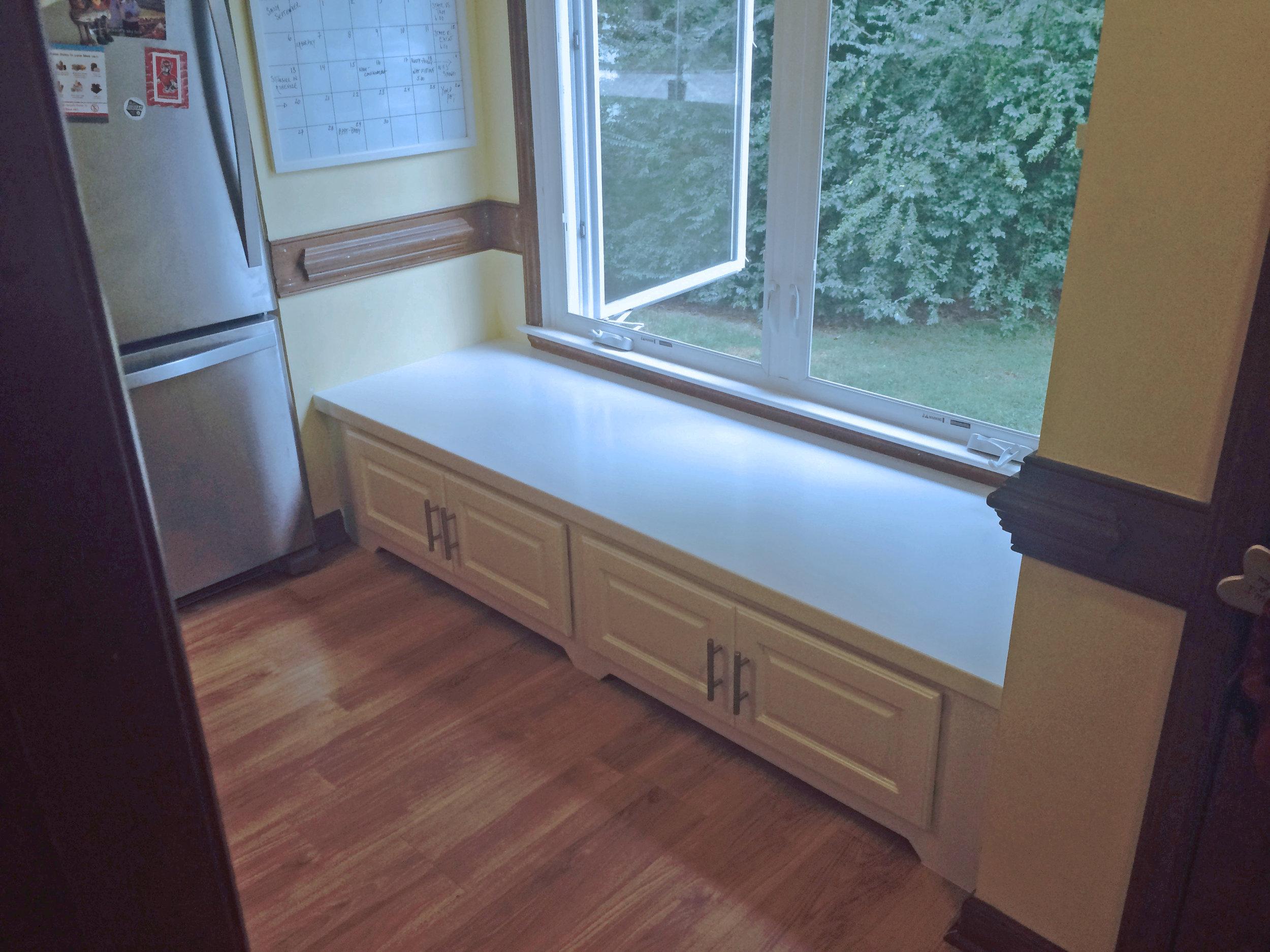 Window Seat with Raised Panel Doors & Toe Kick Detail