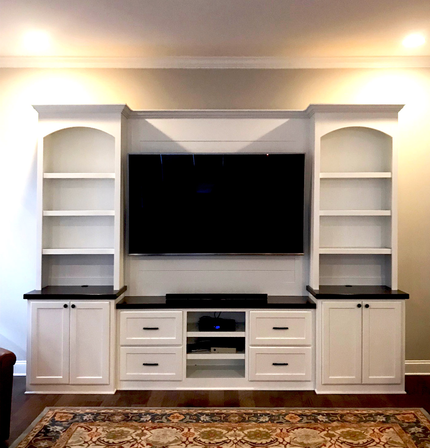 Built-In with Arches, Shiplap Backer, Shaker Doors & Drawers, Console & TV Openings, Stain Countertops, and Crown