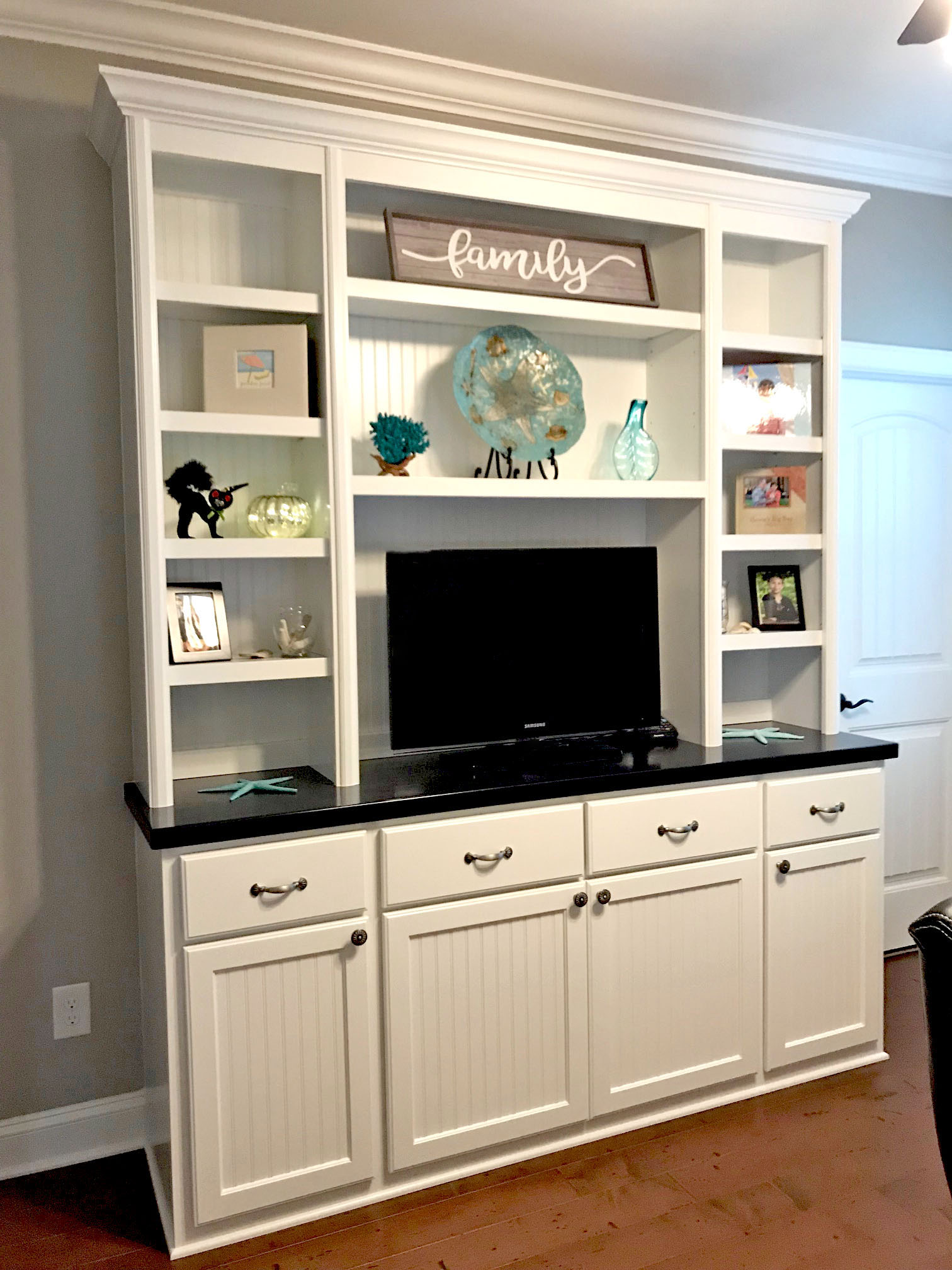 Built-In with Beadboard Backer, Adjustable Shelves, TV Opening, Stain Countertop, Slab Drawers, and Shaker Beadboard Doors