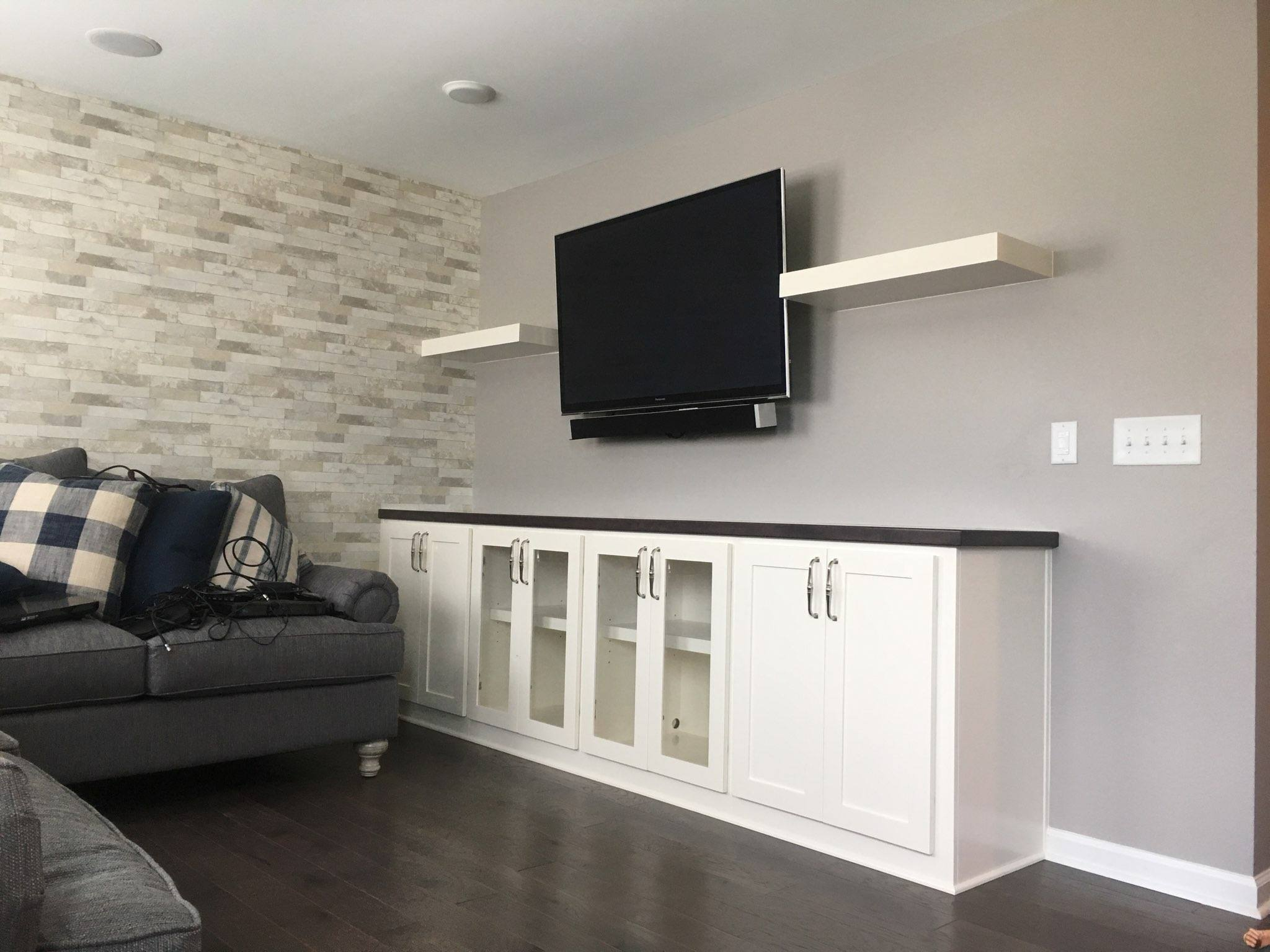 Built-In with Floating Shelves, Stain Countertop, Solid Shaker Doors, and Clear Glass Doors
