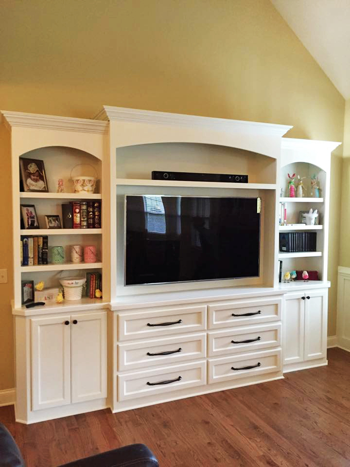 Built-In with Arch Detail, Adjustable Shelves, TV Opening, Shaker Doors & Drawers, Clipped Corners, and Crown