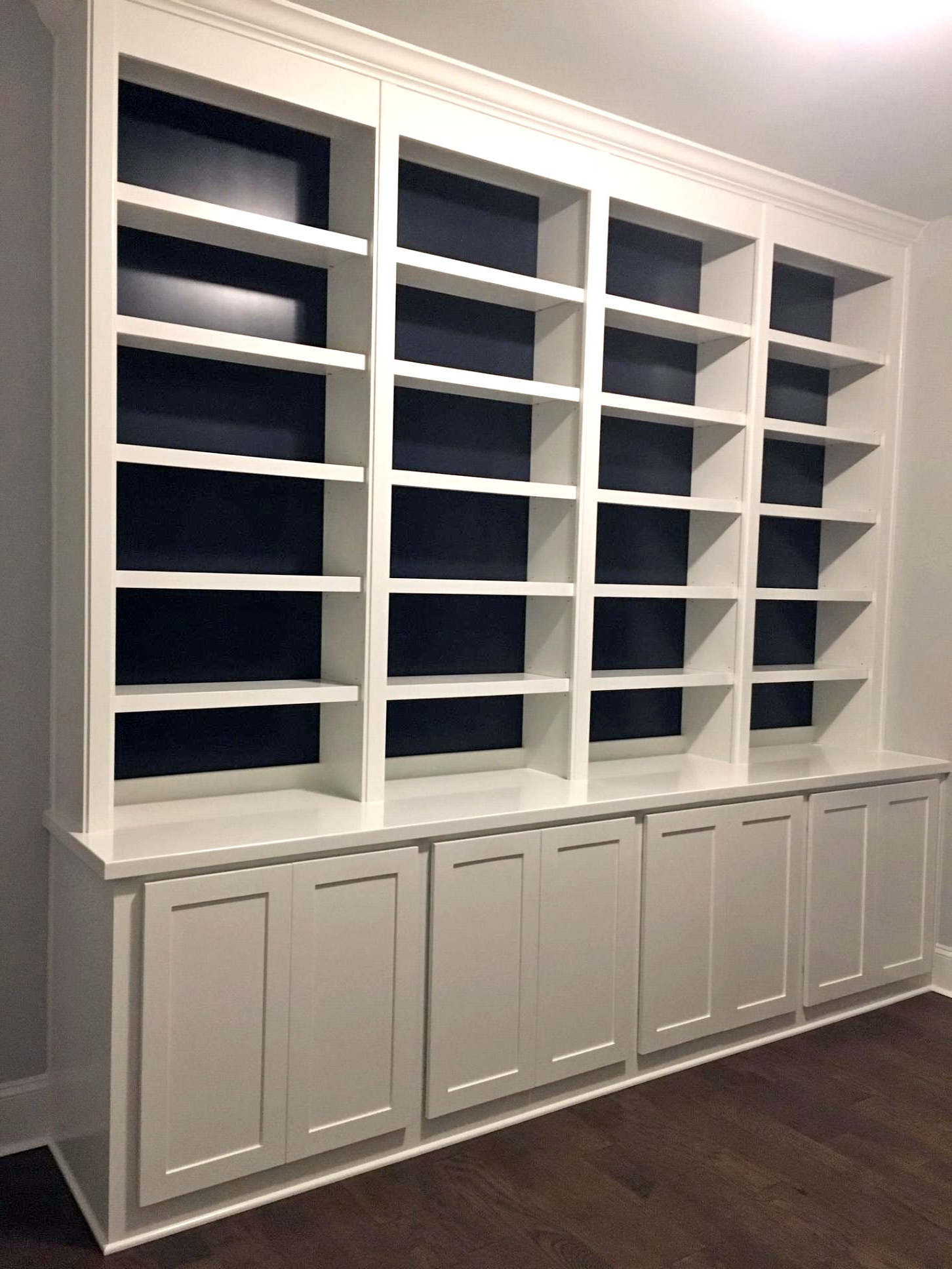 Built-In with Accent Backer Color, Adjustable Shelves, Face Frame Detail, Shaker Doors, and Crown