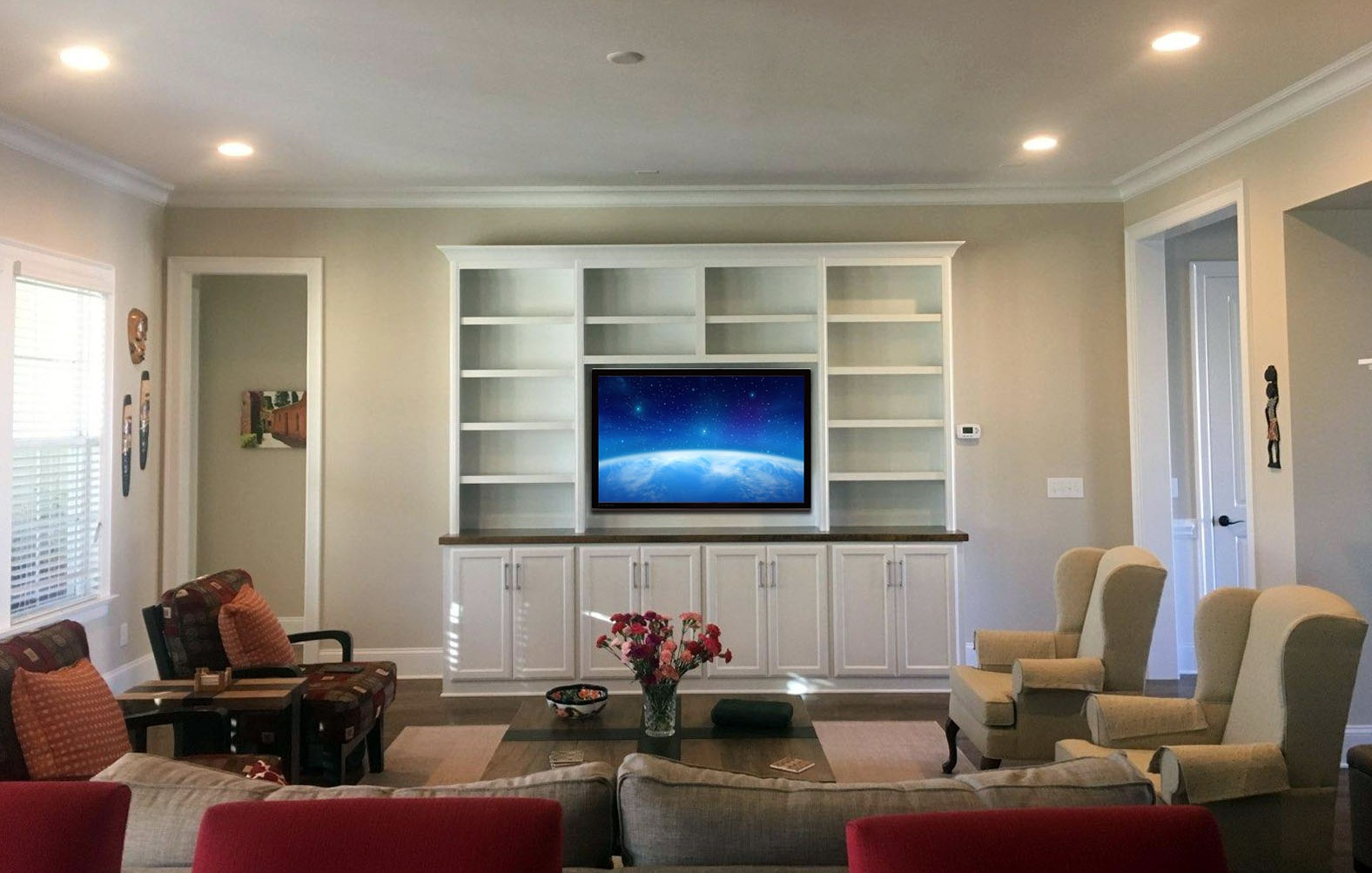 Built-In with Adjustable Shelves, TV Opening, Shaker Doors, Stain Countertop, and Crown Detail