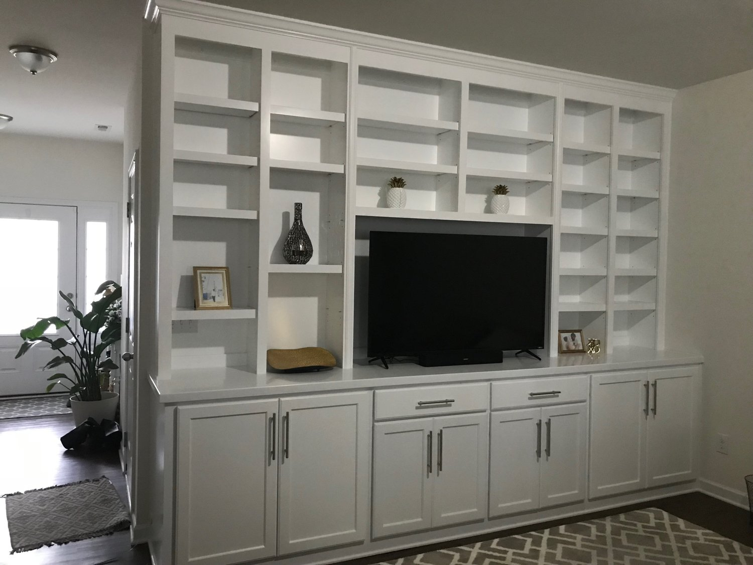Built-In with Adjustable Shelves, TV Opening, Shaker Doors, Slab Drawers & Crown
