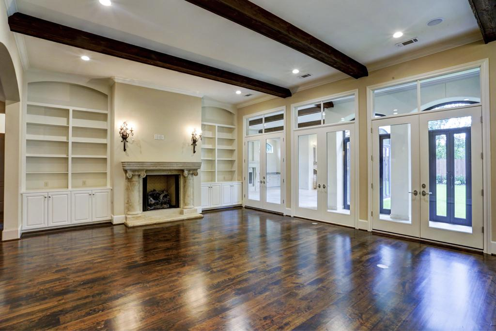 Fireplace Built-Ins with Adjustable Shelves, Arches, Raised Panel Doors, and Crown