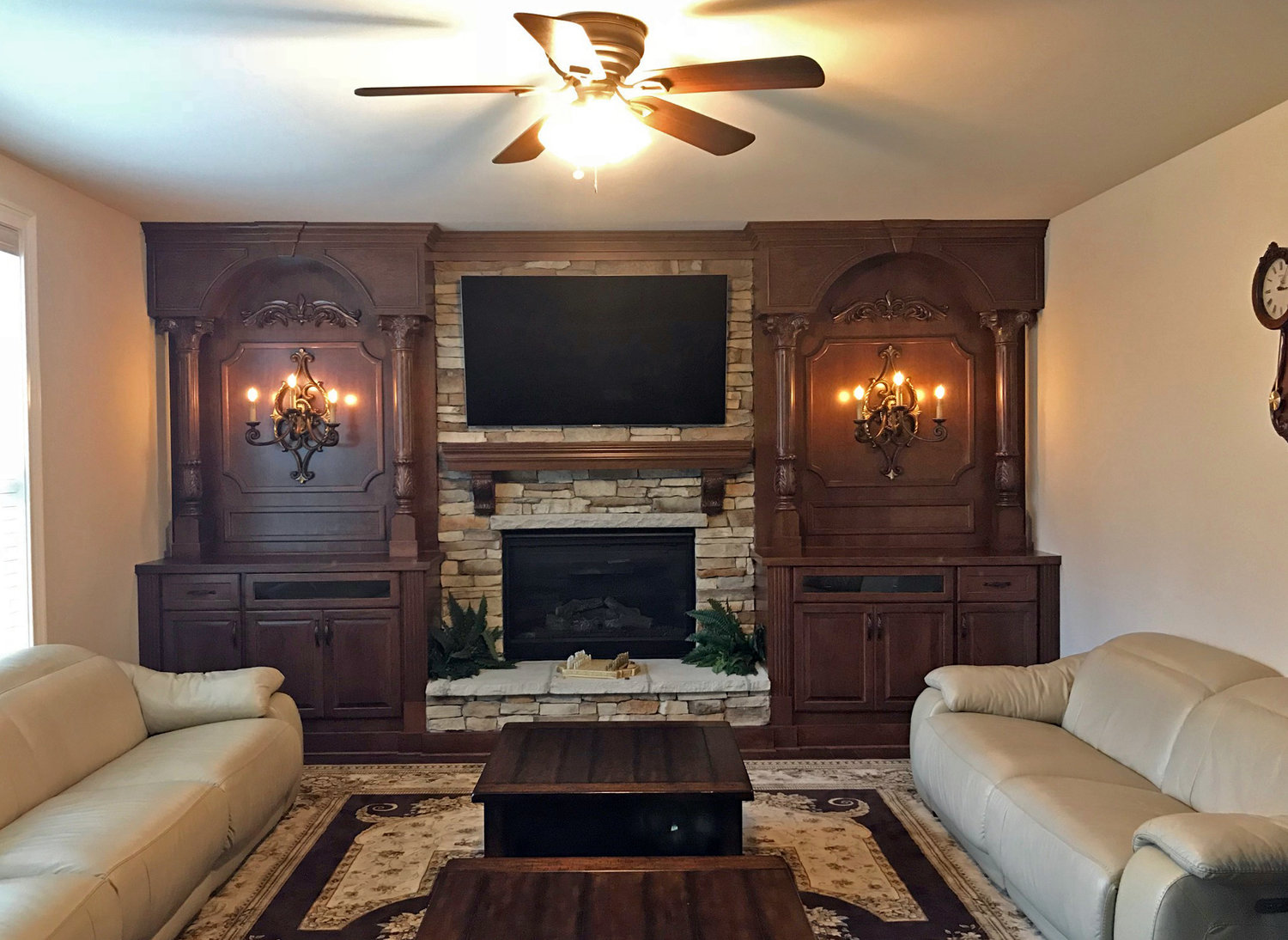 Fireplace Built-Ins with Shaker Doors, Custom Molding Details and Columns, and Arches