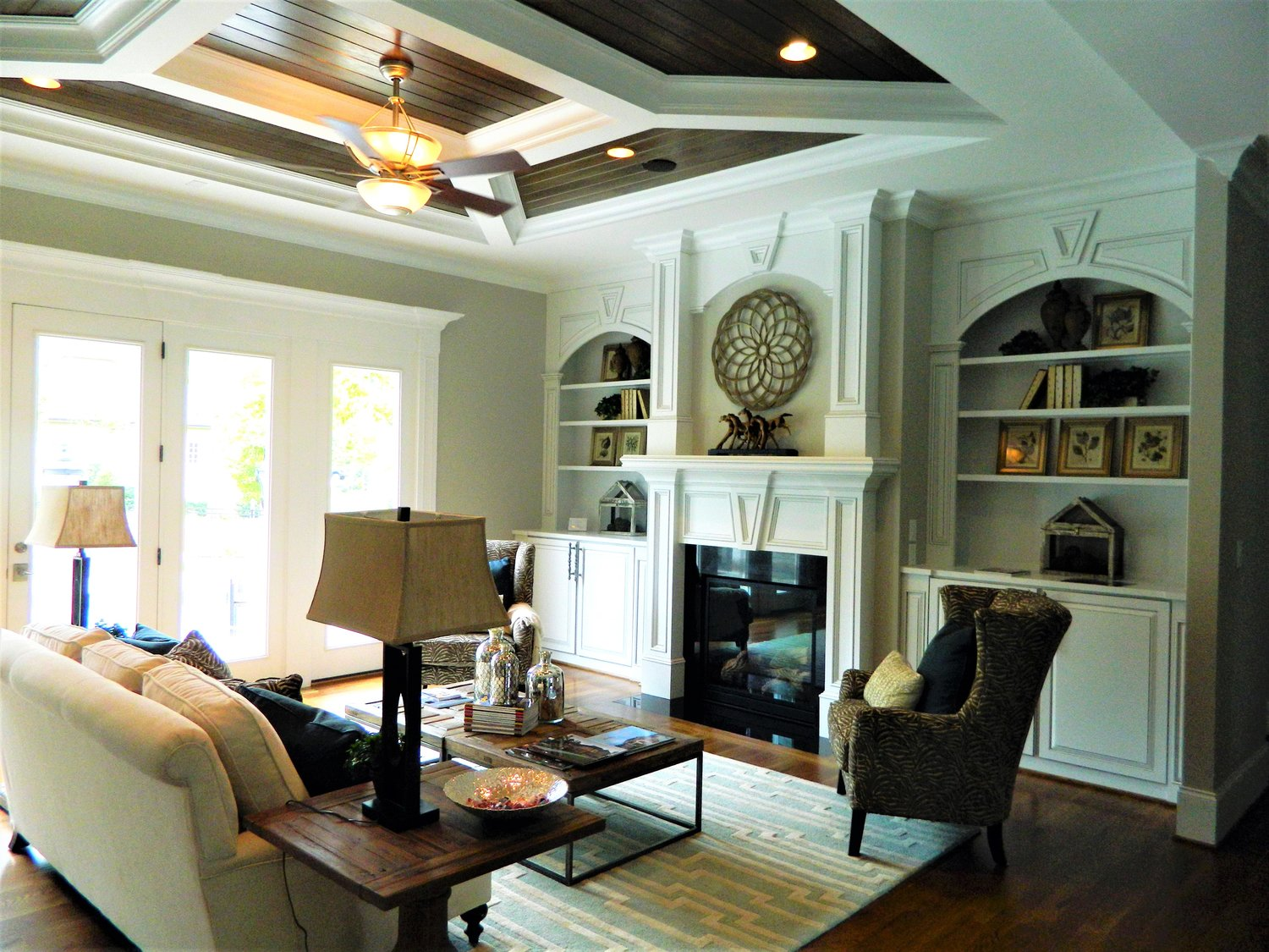 Fireplace Built-In with Adjustable Shelves, Raised Panel Doors, Applied Panel Detail, Keystone, Columns, and Crown
