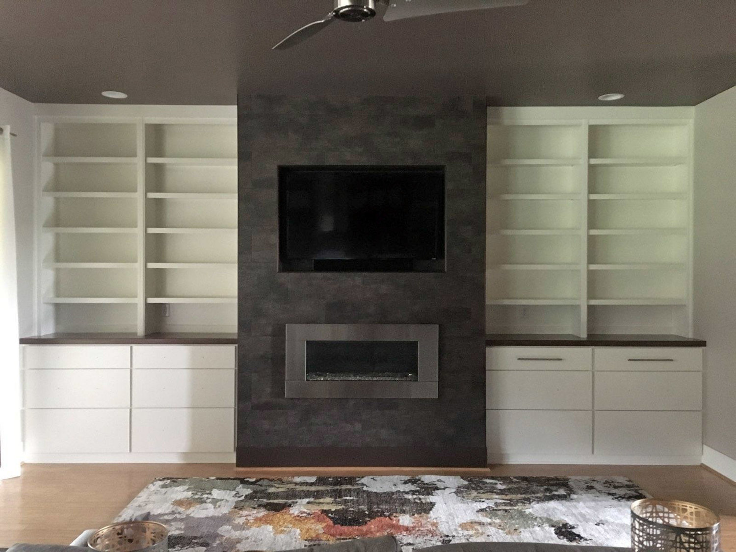 Fireplace Built-Ins with Adjustable Shelves, Slab Drawers, Stain Countertops, and Crown