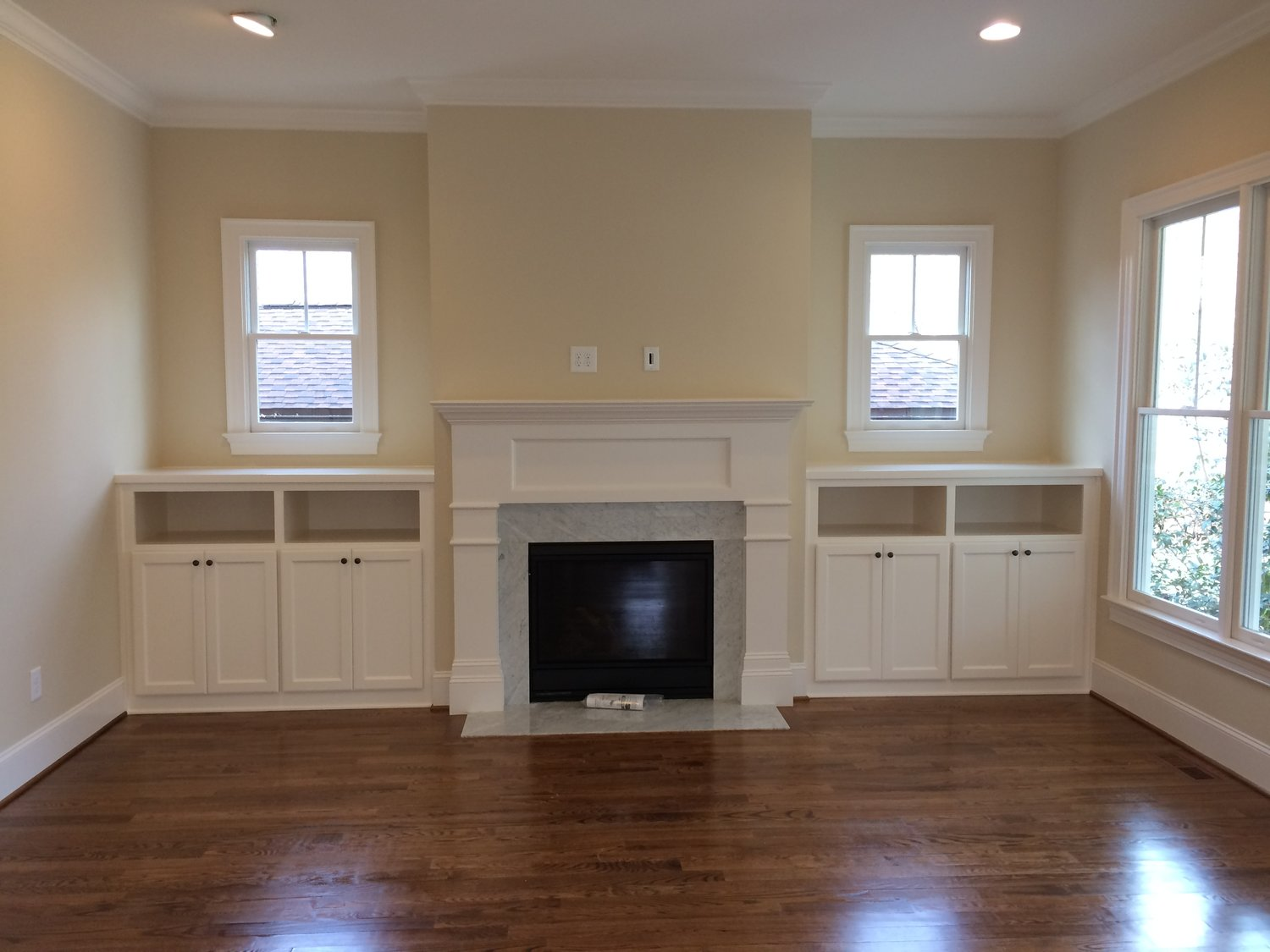 Fireplace Built-Ins with Shaker Doors, Open Cubbies, and Countertops