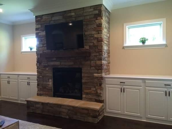 Fireplace Built-Ins with Raised Panel Doors, Slab Drawers, and Countertops