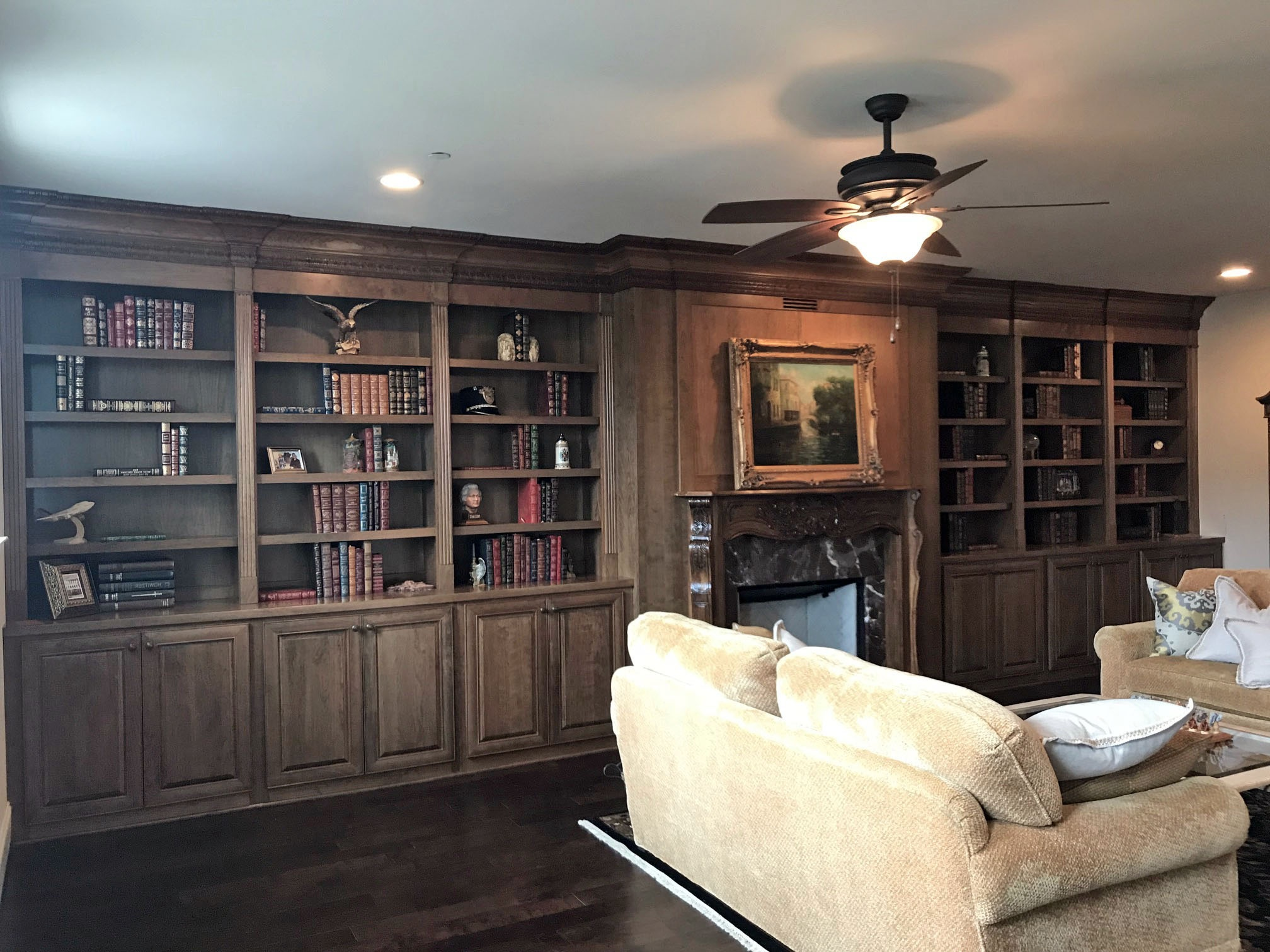 Fireplace Built-Ins with Adjustable Shelves, Raised Panel Doors, Fluting & Column Detail, and Custom Crown