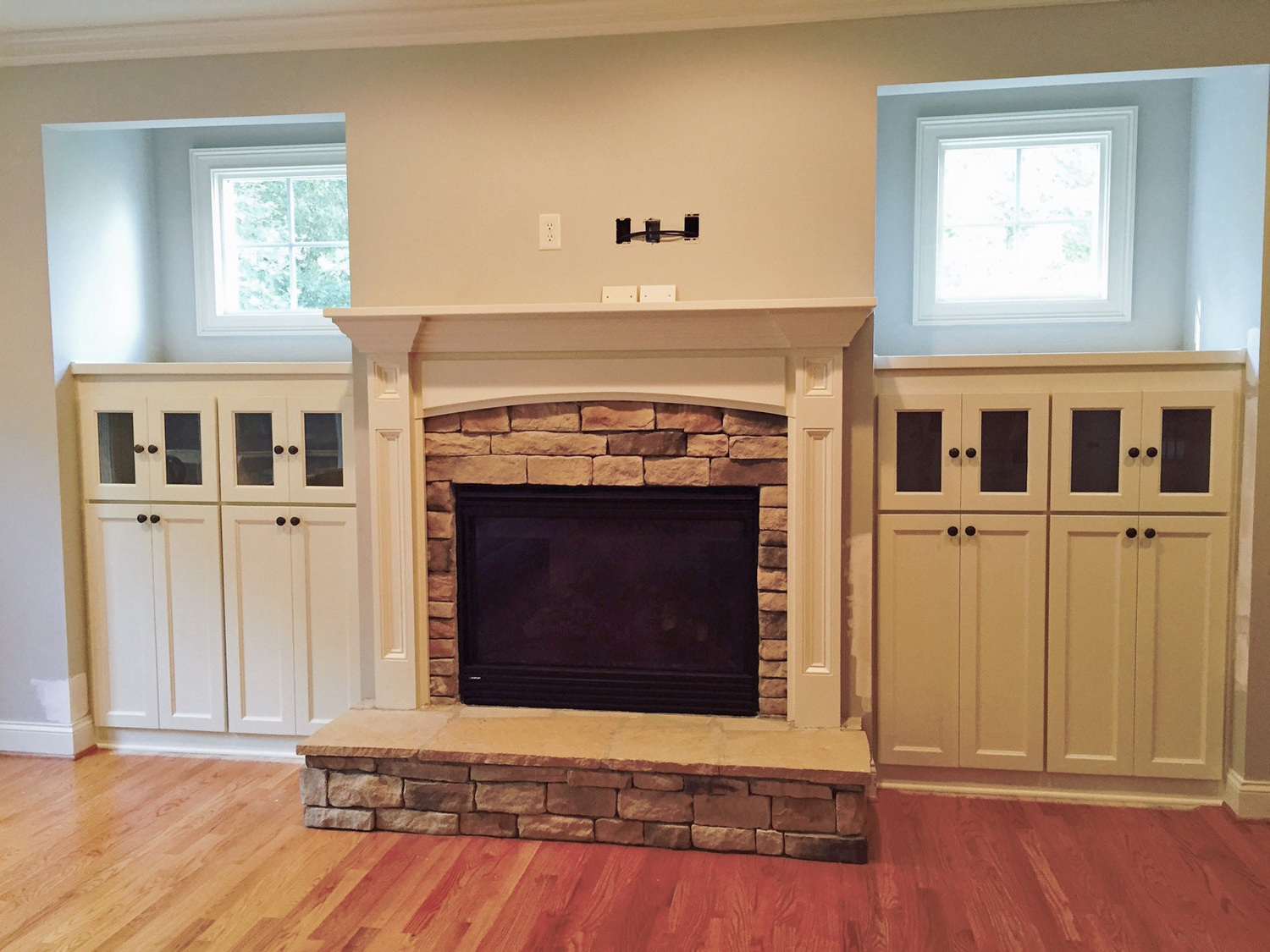 Fireplace Built-ins with Shaker Doors, Glass Doors, and Countertops