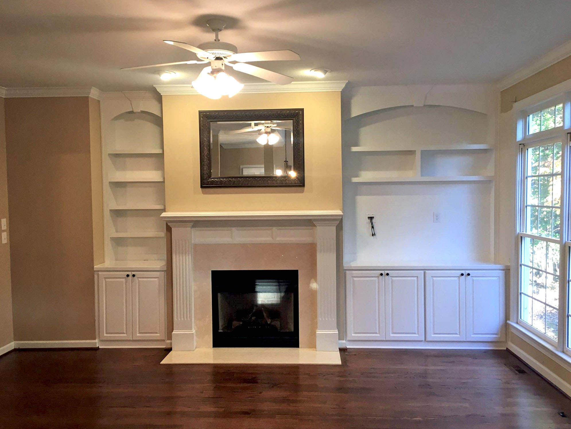 Fireplace Built-Ins with Adjustable Shelves, Arches, Keystone, Raised Panel Doors, TV Opening, and Crown