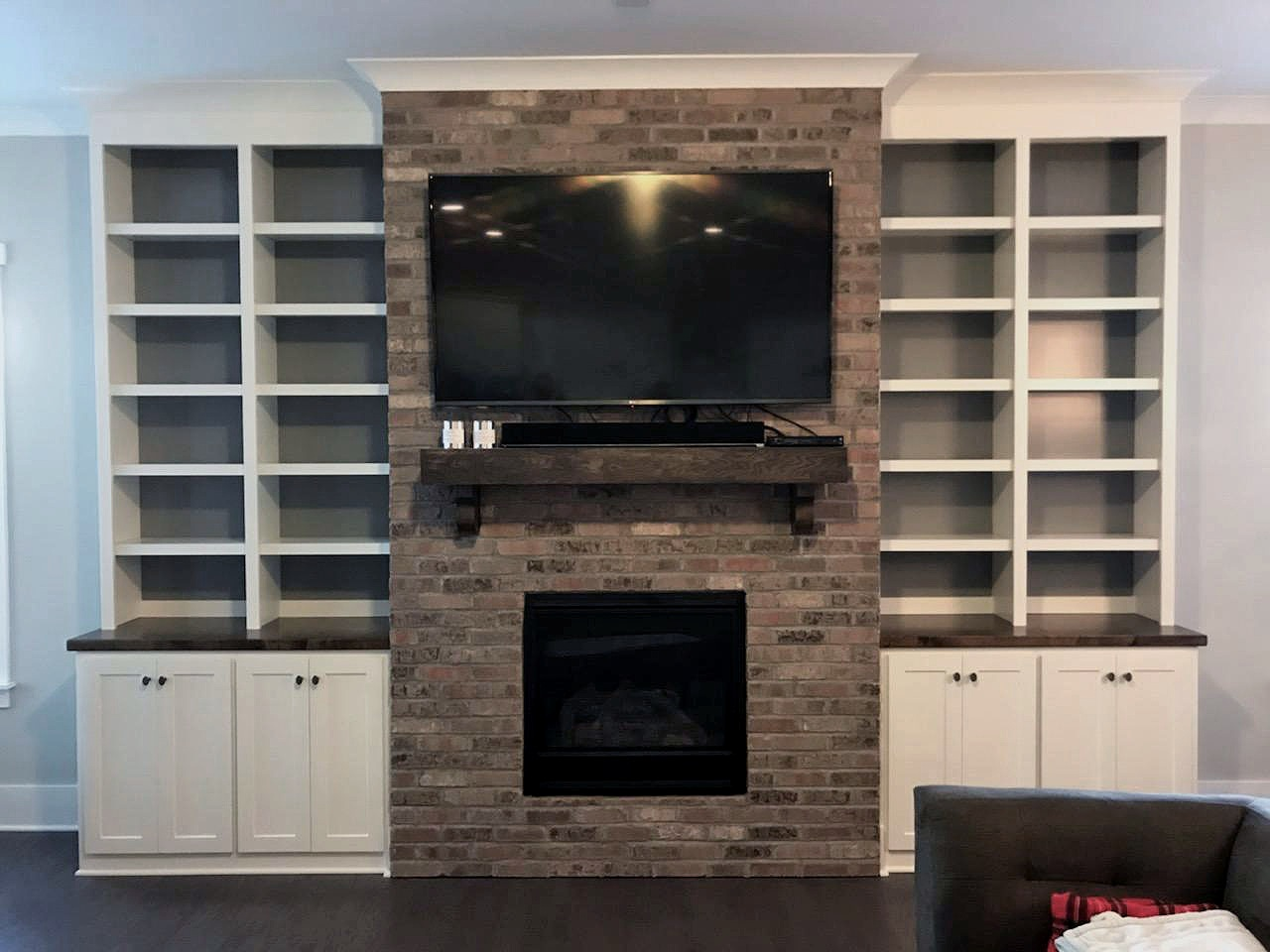 Fireplace Built-Ins with Adjustable Shelves, Accent Backer Color, Shaker Doors, and Crown