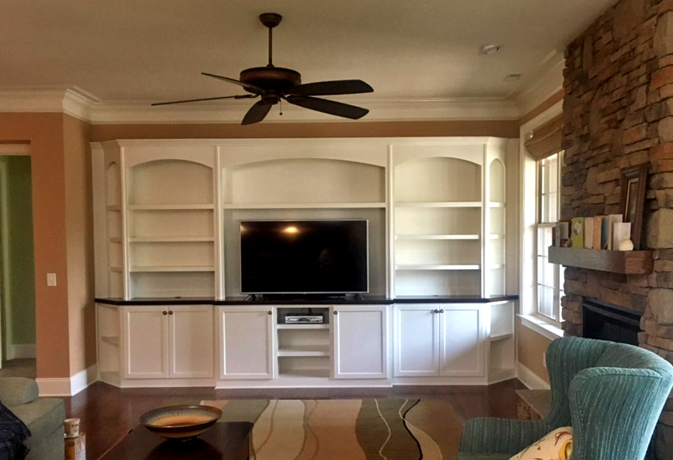 Built-In with Arch Detail, Adjustable Shelves, Clipped Corners, Shaker Doors, and Crown