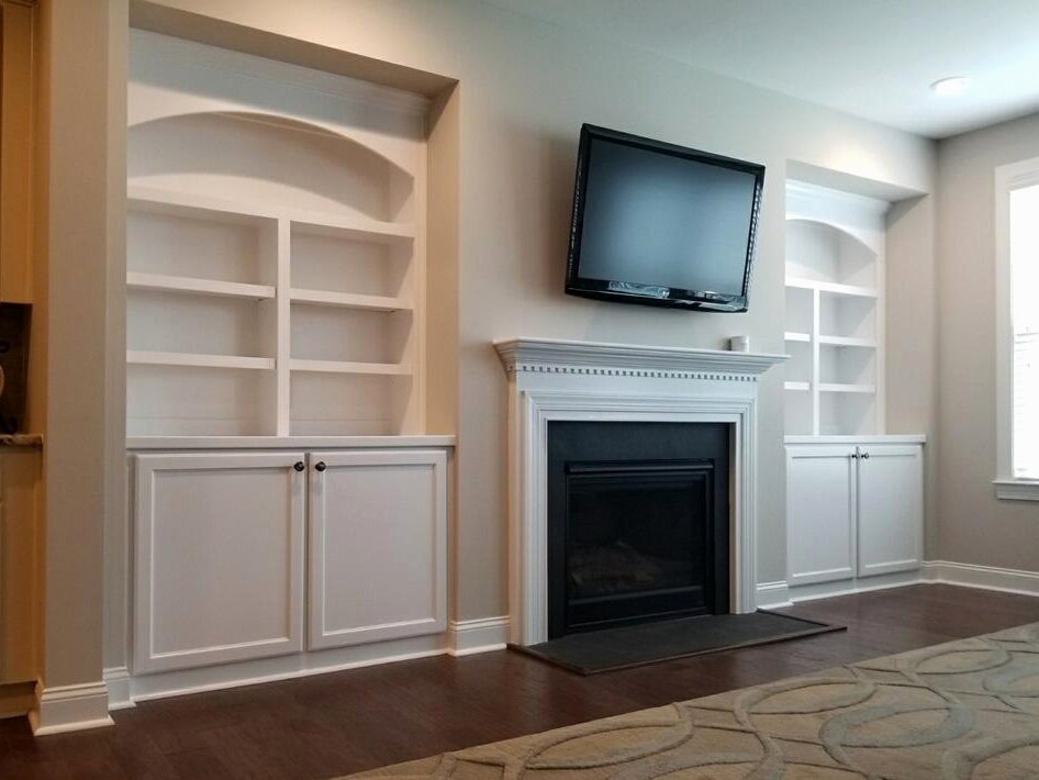Fireplace Built-Ins with Adjustable Shelves, Arches, Shaker Doors, and Crown