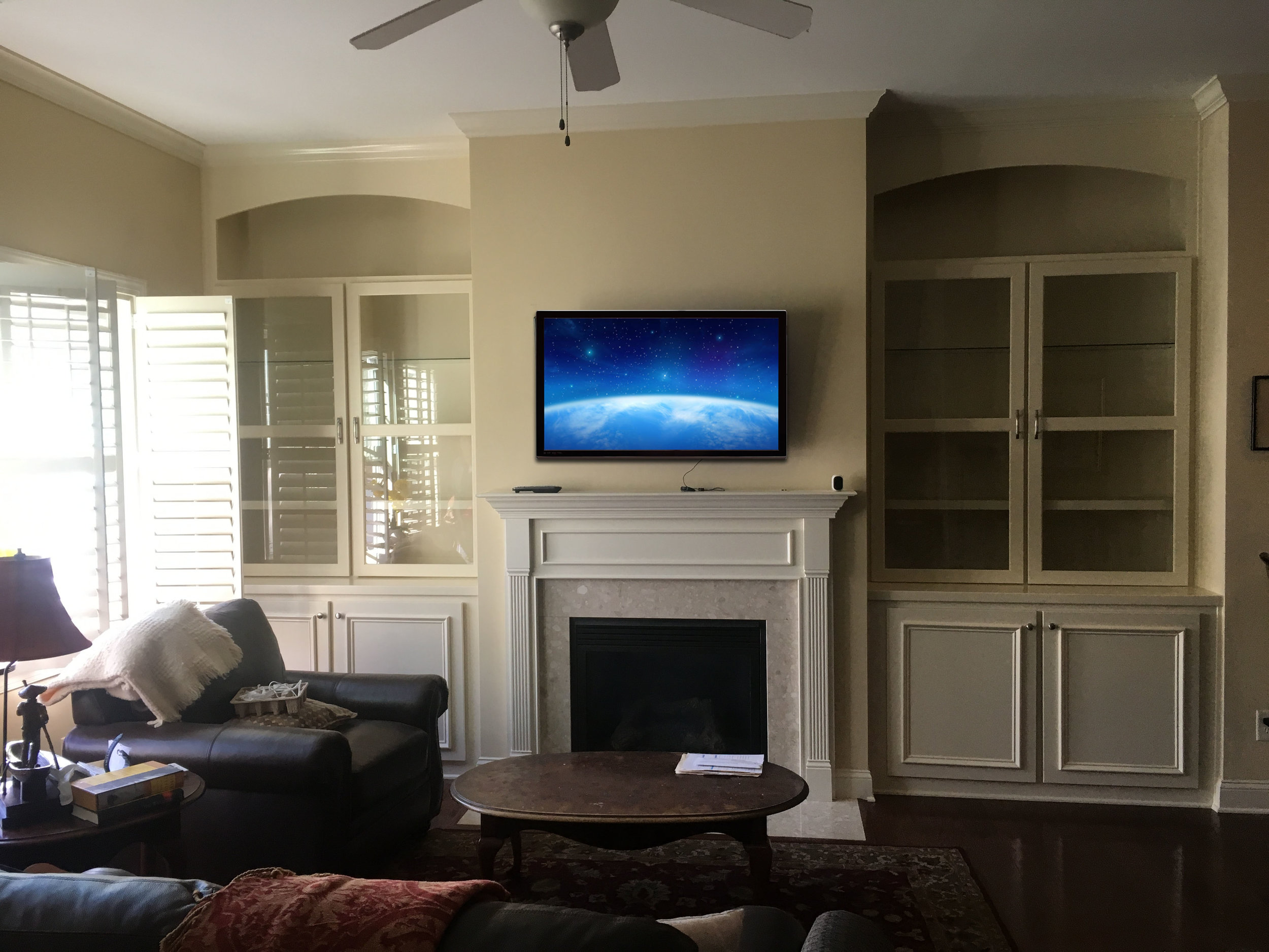 Fireplace Built-Ins with Applied Panel Detail Doors, Arch Detail, Glass Adjustable Shelves, Glass Doors, and Crown