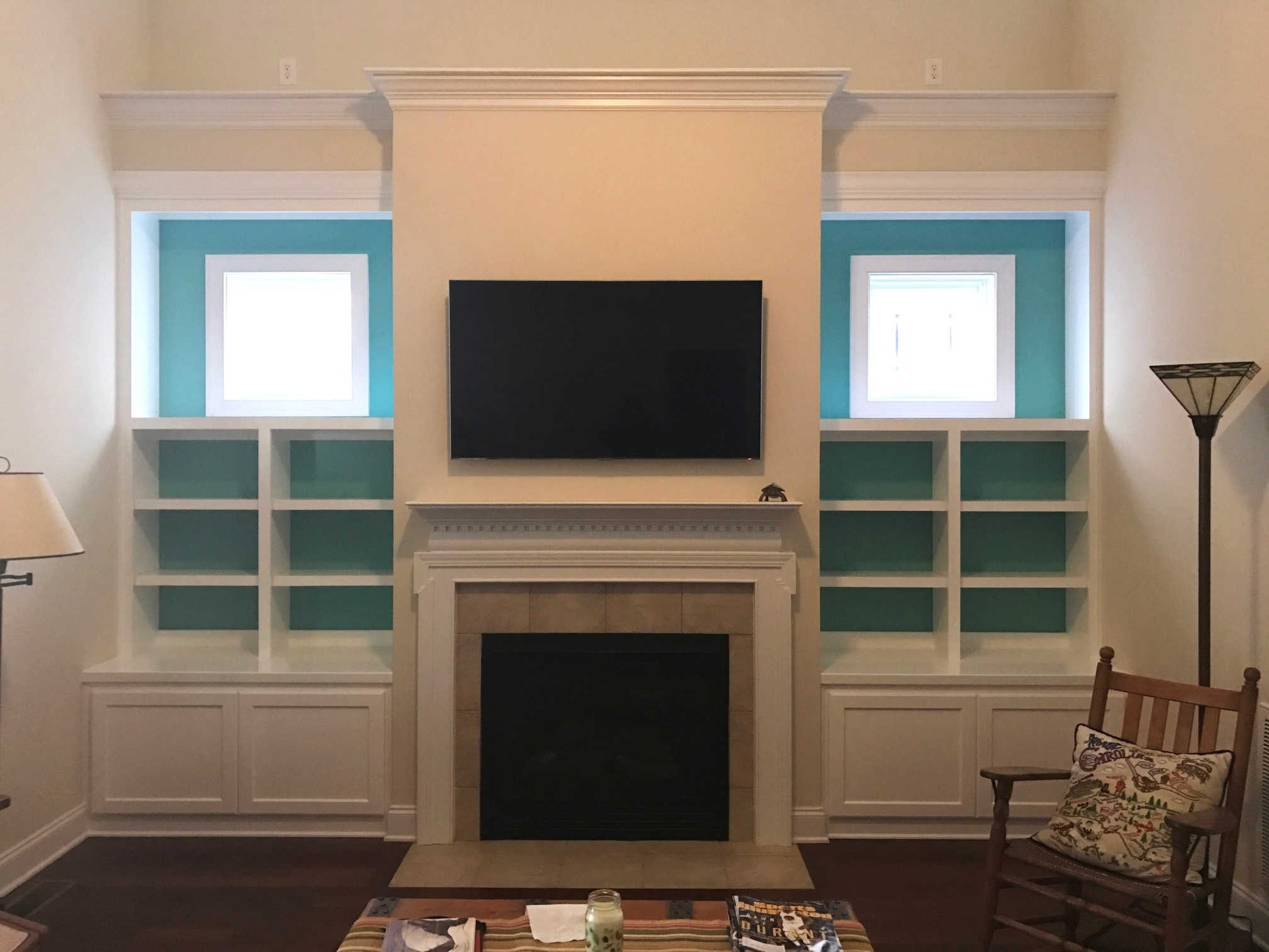 Fireplace Built-Ins with Accent Backer, Adjustable Shelves, Shaker Doors, and Crown