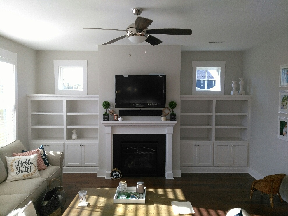 Fireplace Built-Ins with Adjustable Shelves, Shaker Doors, and Cap Detail