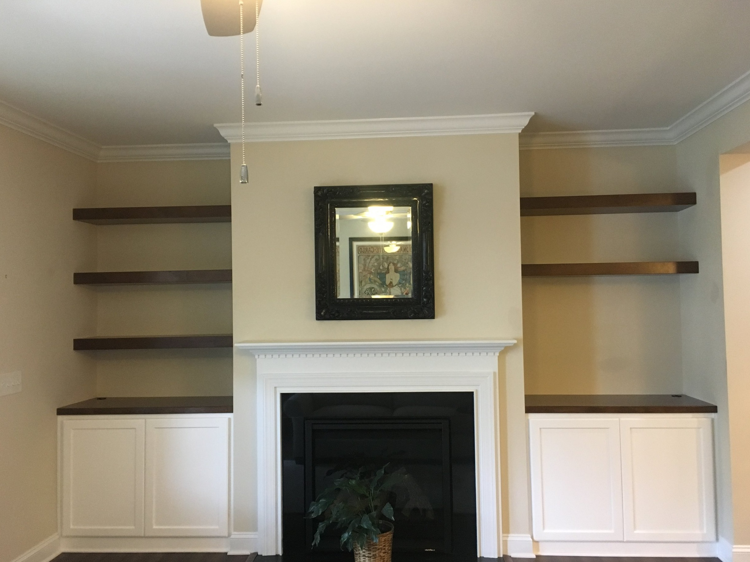 Fireplace Built-Ins with Shaker Doors, Stain Countertops, and Stain Floating Shelves