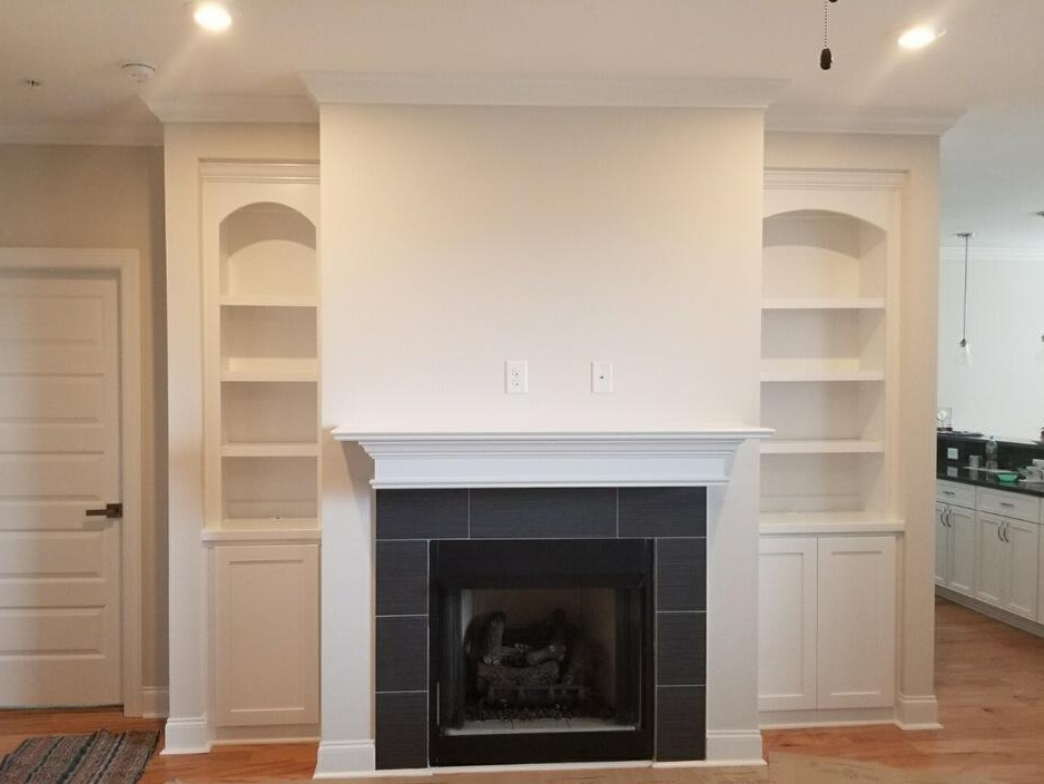 Fireplace Built-Ins with Arches, Adjustable Shelves, Shaker Doors, and Crown
