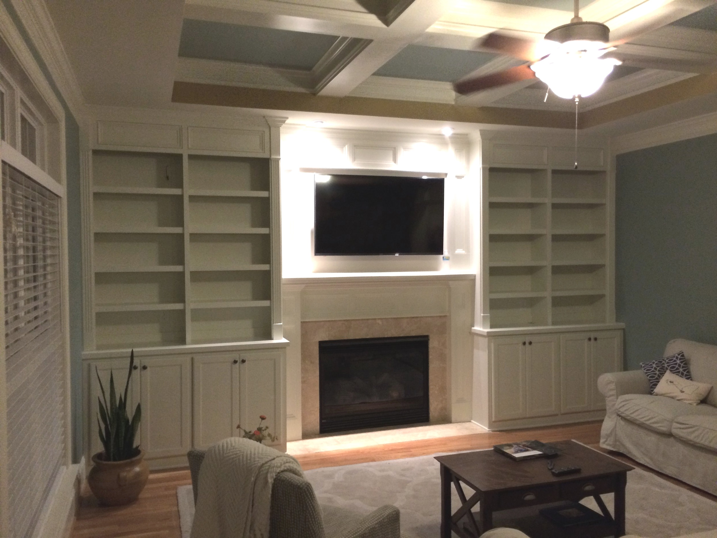 Fireplace Built-Ins with Adjustable Shelves, Shaker Doors, Applied Panel Header Detail, and Crown