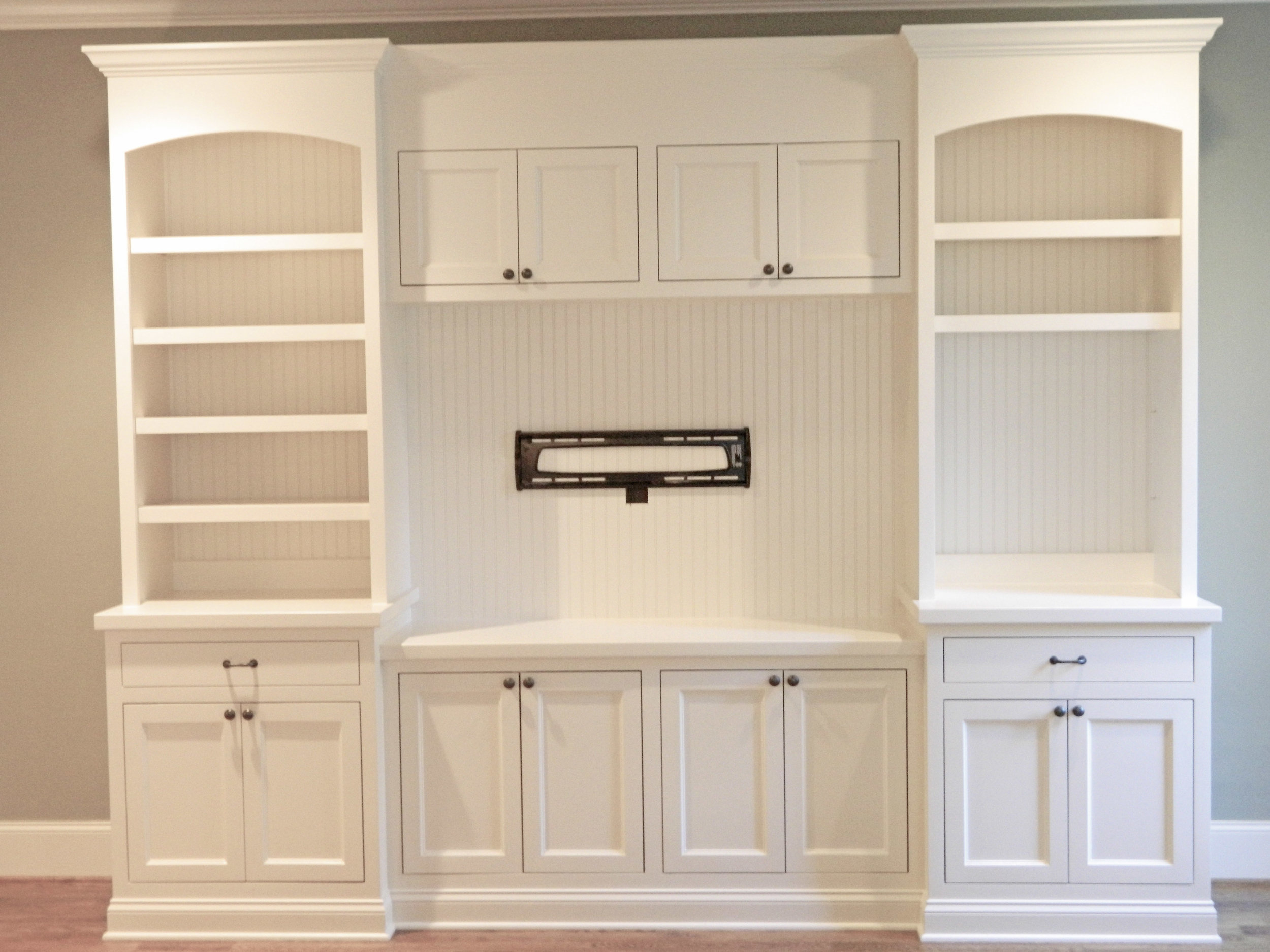 Built-In with Inset Shaker Doors, Inset Drawers, Arches, Header, Crown, and Beadboard Backer