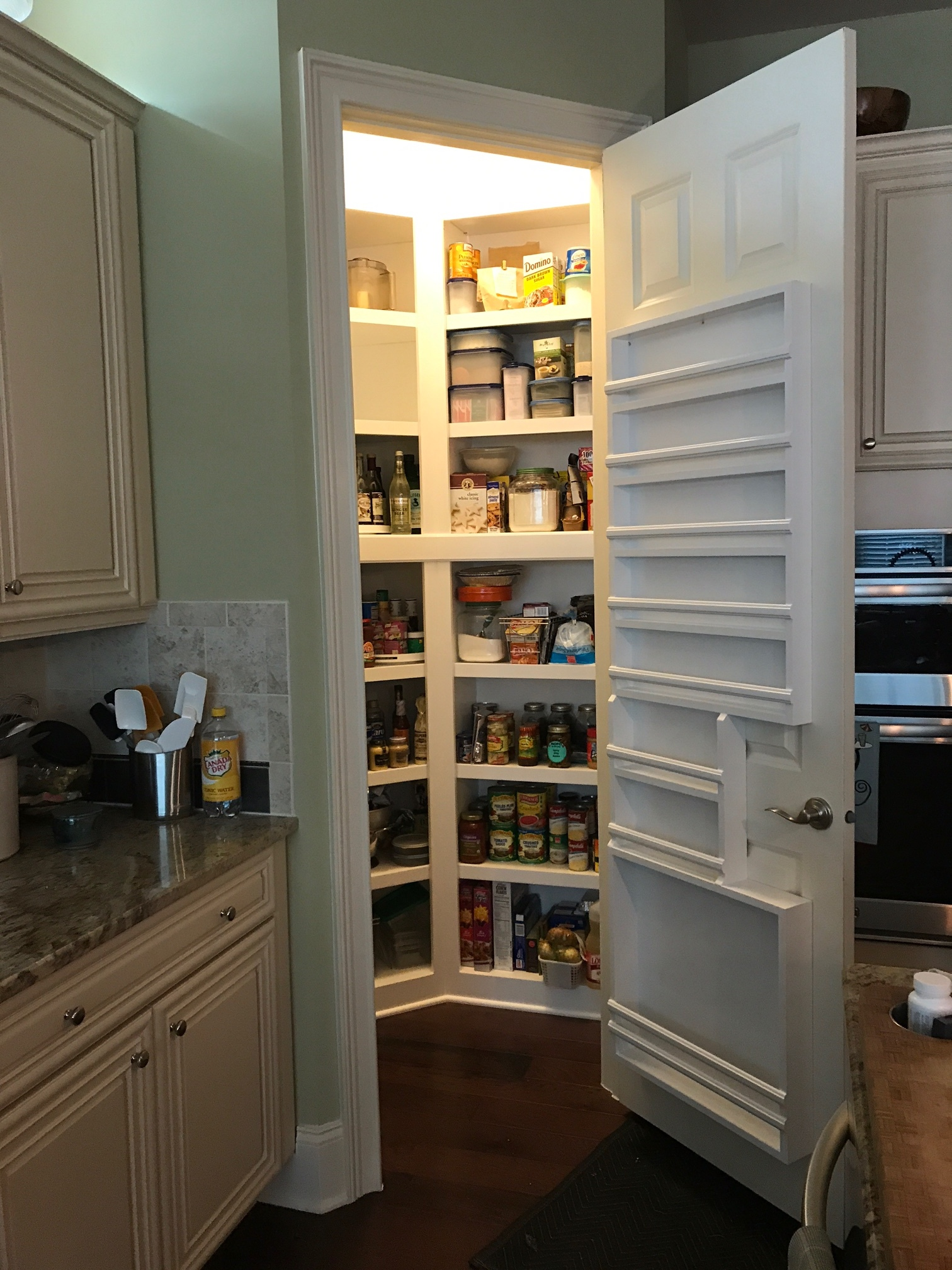 Custom Angled Pantry with Enclosed Bottom & Fixed Shelves, and Door Spice Rack