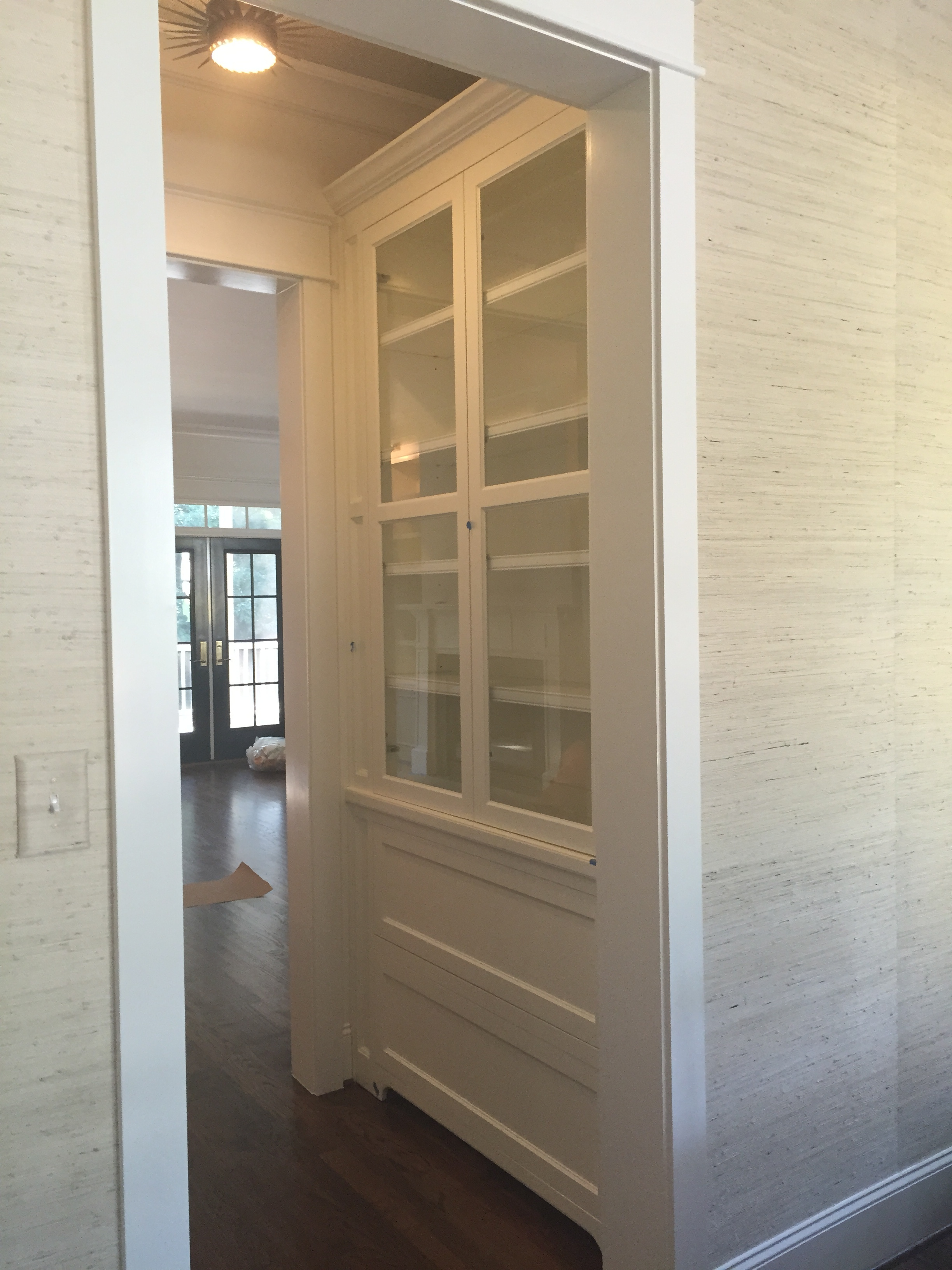 Custom Flush Butler's Pantry with Clear Glass Shelves, Inset Doors, Toe-Kick, and Crown