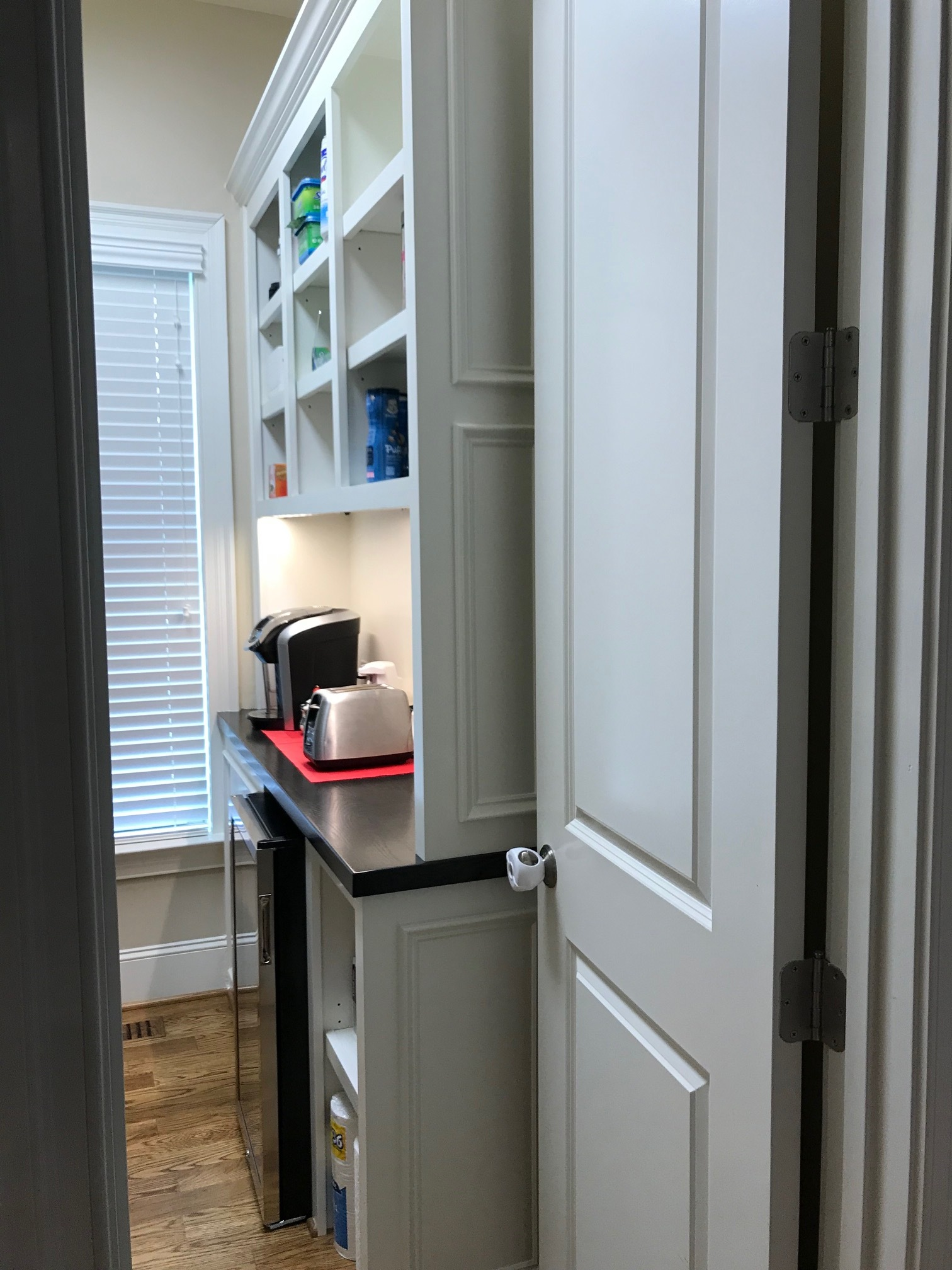 Custom Walk-In Pantry with Adjustable Shelves, Applied Panel Detail, and Crown