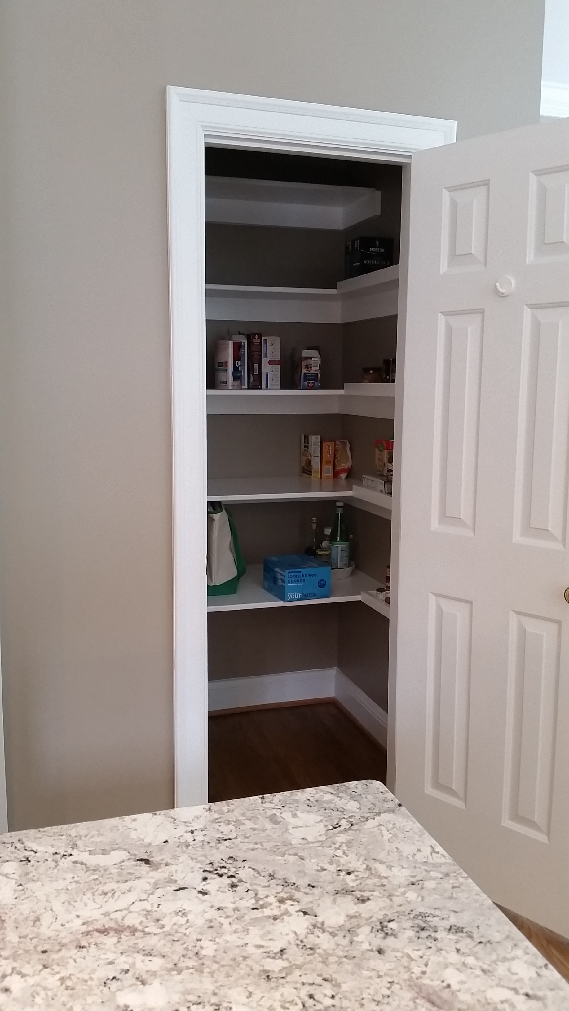 Custom U-Shaped Reach in Pantry with Cleated Shelves & Lip for Spices and Cans
