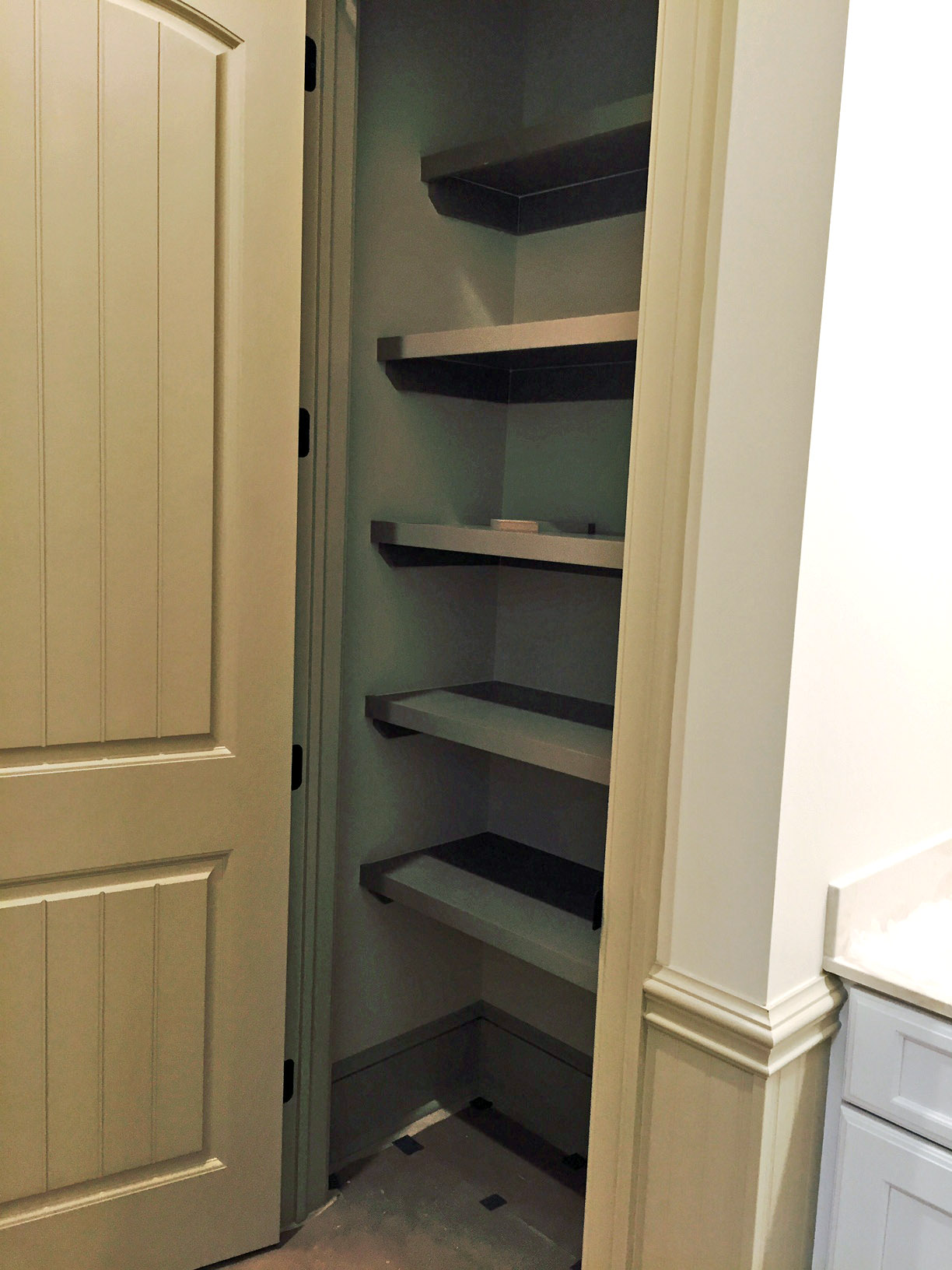 Custom Reach-In Pantry with Multiple Depth Cleated Shelves