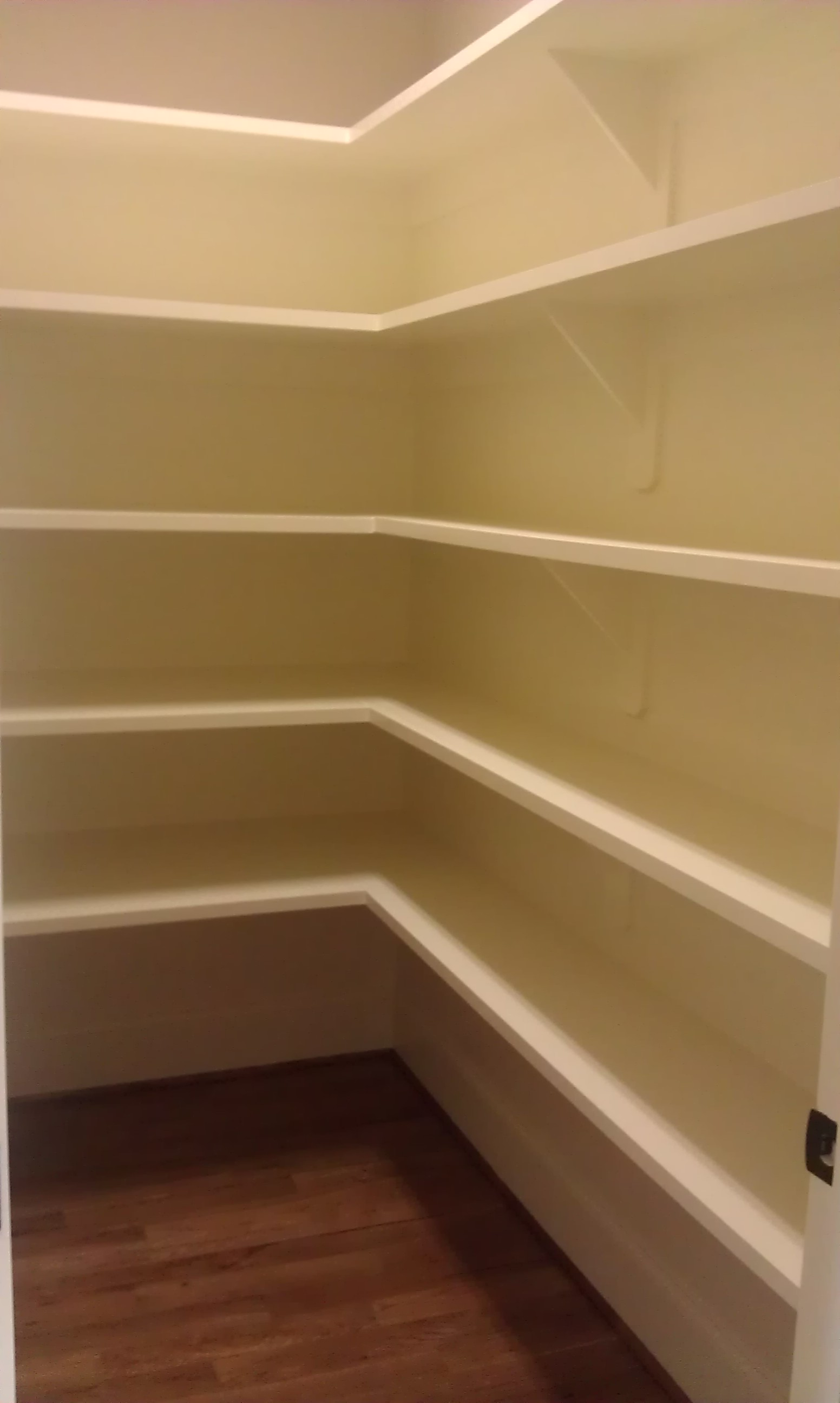 Custom L-Shaped Reach-In Pantry with Cleated Shelves