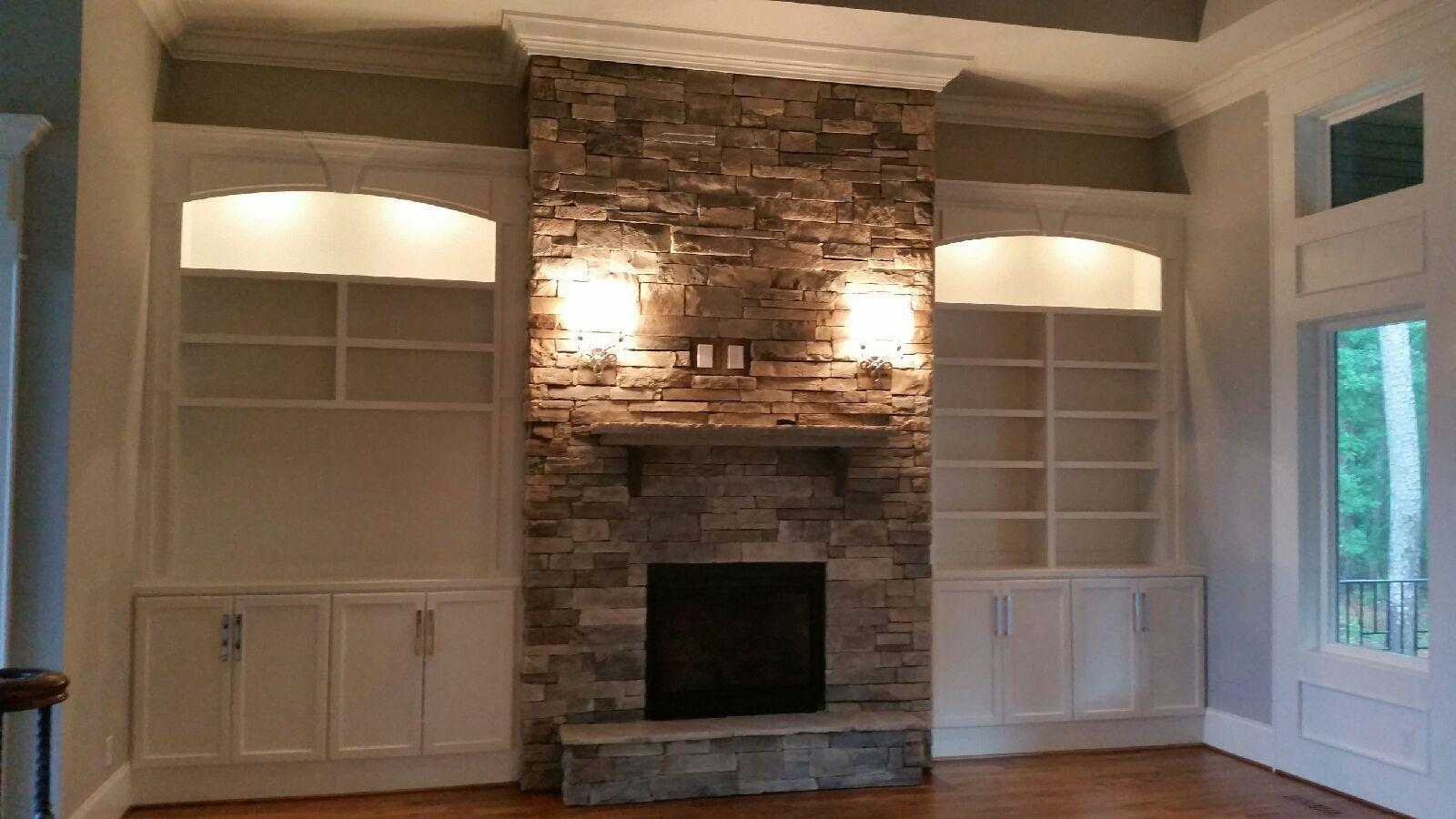 Fireplace Built-Ins with Arches, Keystone and Applied Panel Detail, Shaker Doors, Adjustable Shelves, TV Opening, and Crown