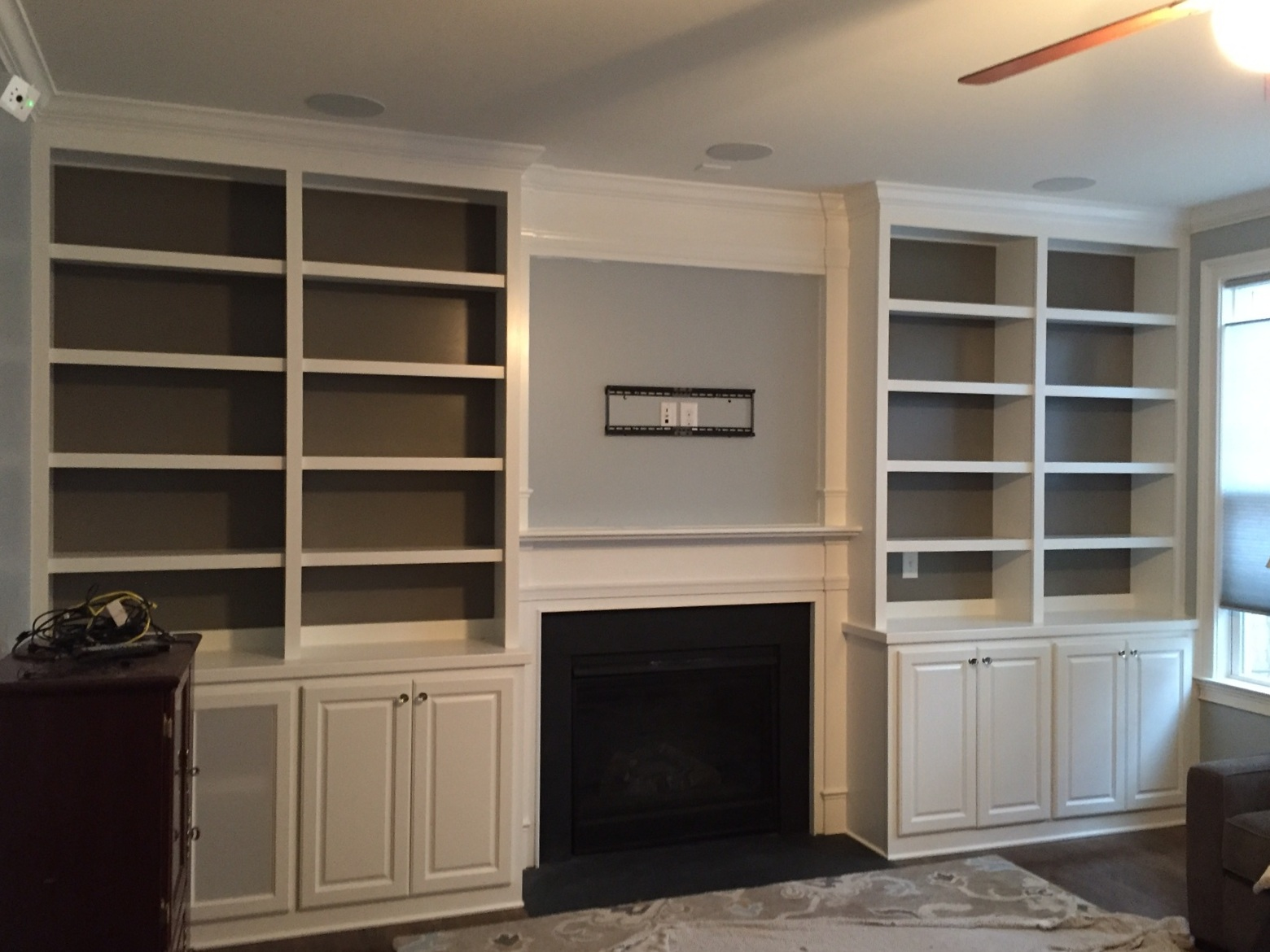 Fireplace Built-Ins with Adjustable Shelves, Raised Panel Doors, Mesh Doors for Components, Accent Backer Color, and Crown