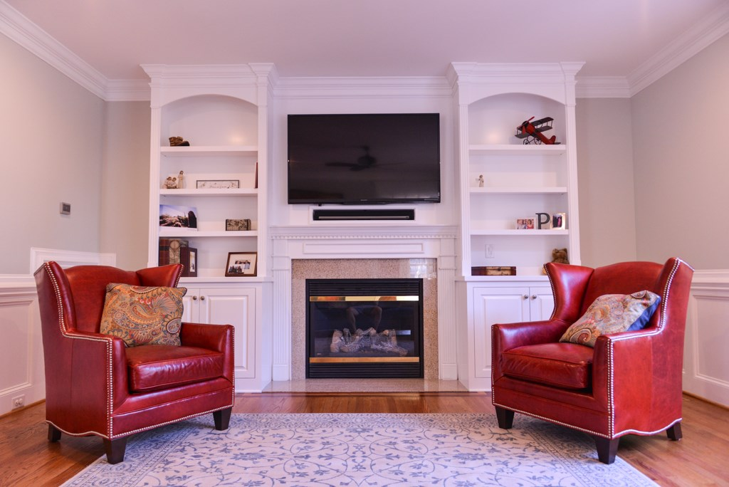 Fireplace Built-Ins with Arches, Fluting, Raised Panel Doors, Adjustable Shelves, Smooth Upper Mantel Panel, and Crown