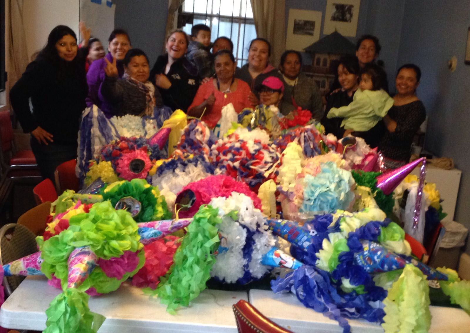 """Members of the Mis Raices group on """"Día del Niño Eve"""" (the last Friday in April) after delivering all of the piñatas to the Friends of Patterson Park's white house."""