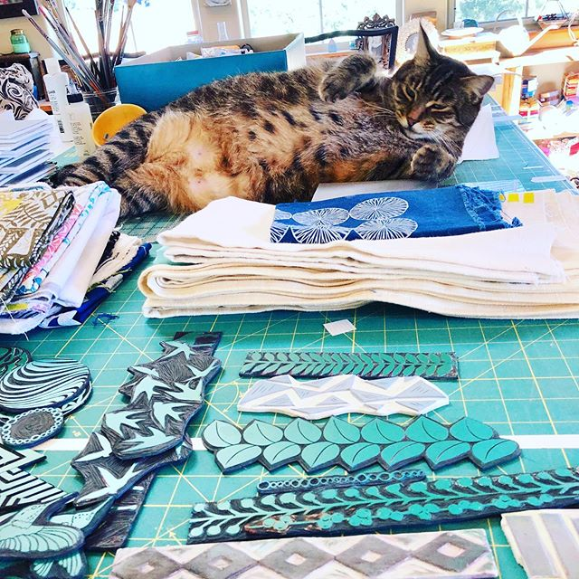 Day 85/100.... I spent the day prepping for my classes at the shop this weekend, @stitchinpost. Basic block printing tomorrow and repeated block printing on Sunday. Ollie was my helper....and yes I did go rub that belly! Swipe to see a few new blocks I carved and printed for class tomorrow. #valoriwells #100dayproject #create #the100dayproject #30minutesofcreativity #createdaily #beinspired #artistoflife #blockprinting #printmaker #printmakersofinstagram #indigo #pattern #repeatedpattern #printingonfabric #maker #handprinting #handblockprinting #speedballart #get_imprinted #stitchinpost #lucyandollie #studiocat
