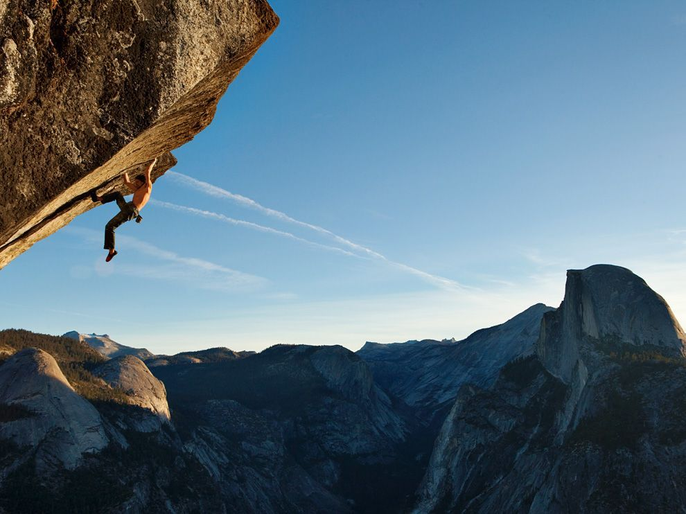 Dean Potter free-climbs a route called Heaven on Glacier Point in Yosemite Park. Photographed by  Mikey Schaefer , for National Geographic May 2011
