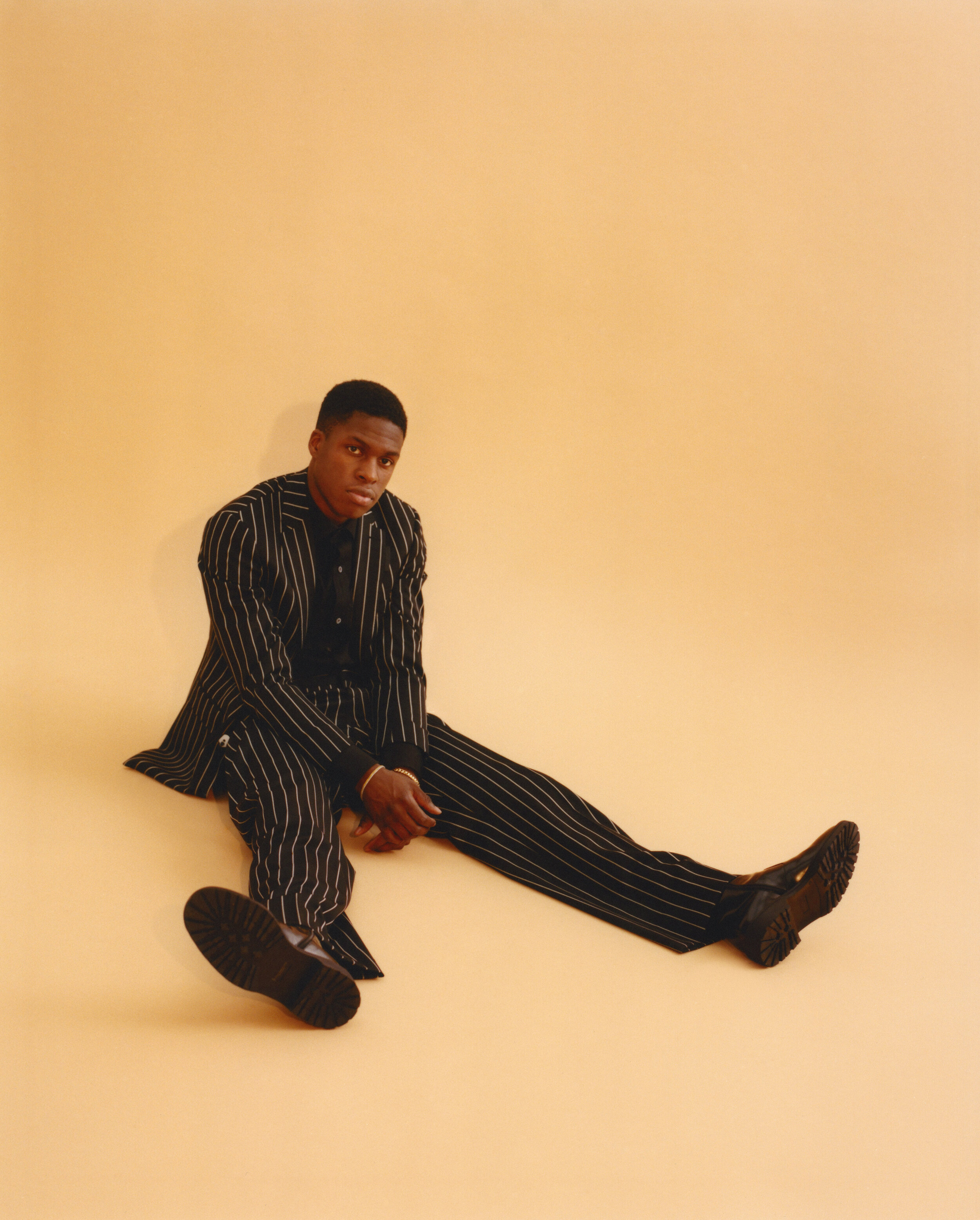 Suit  BURBERRY    Shirt  TOM FORD    Shoes  DRIES VAN NOTEN