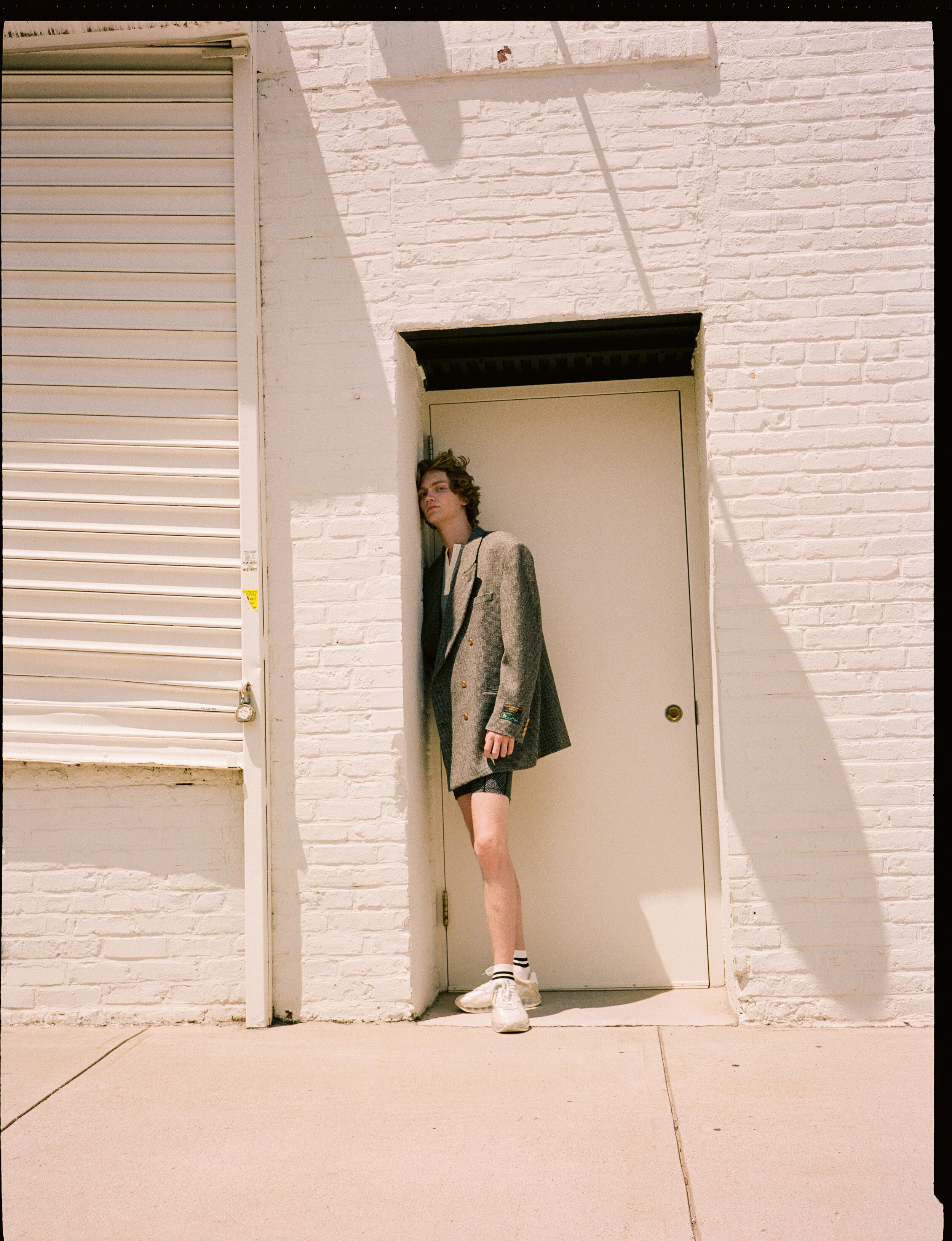Coat  GUCCI  Top  BALLY  Shorts and Shoes  ALEXANDER WANG