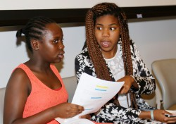 Tamia confers with a SEED Miami student during an end-of-year celebration