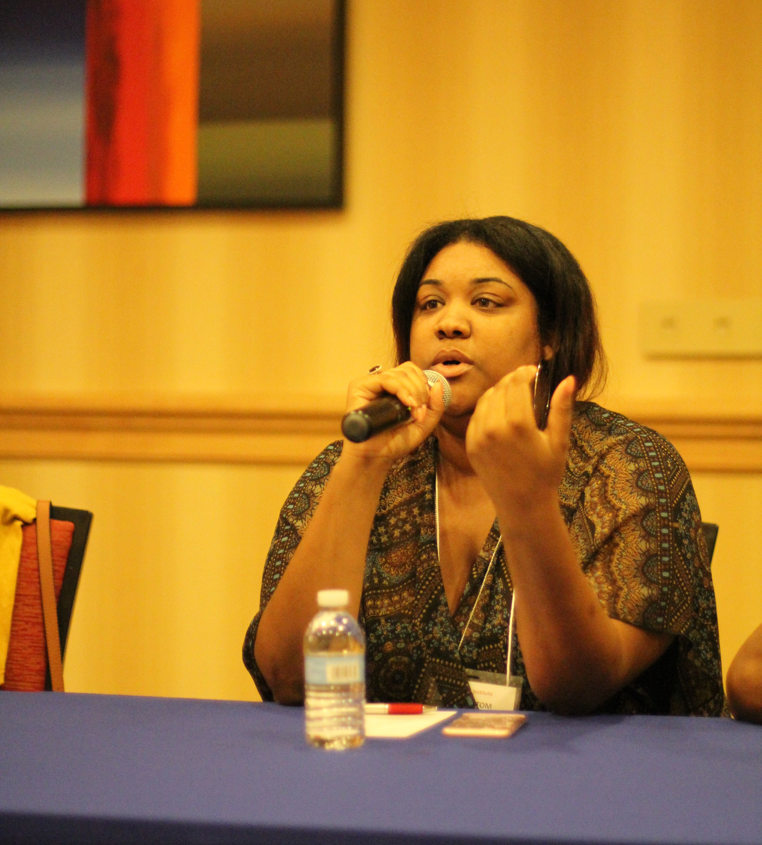 Arnice speaking to younger SEED graduates about her college experience at the annual SEED Graduate Institute.