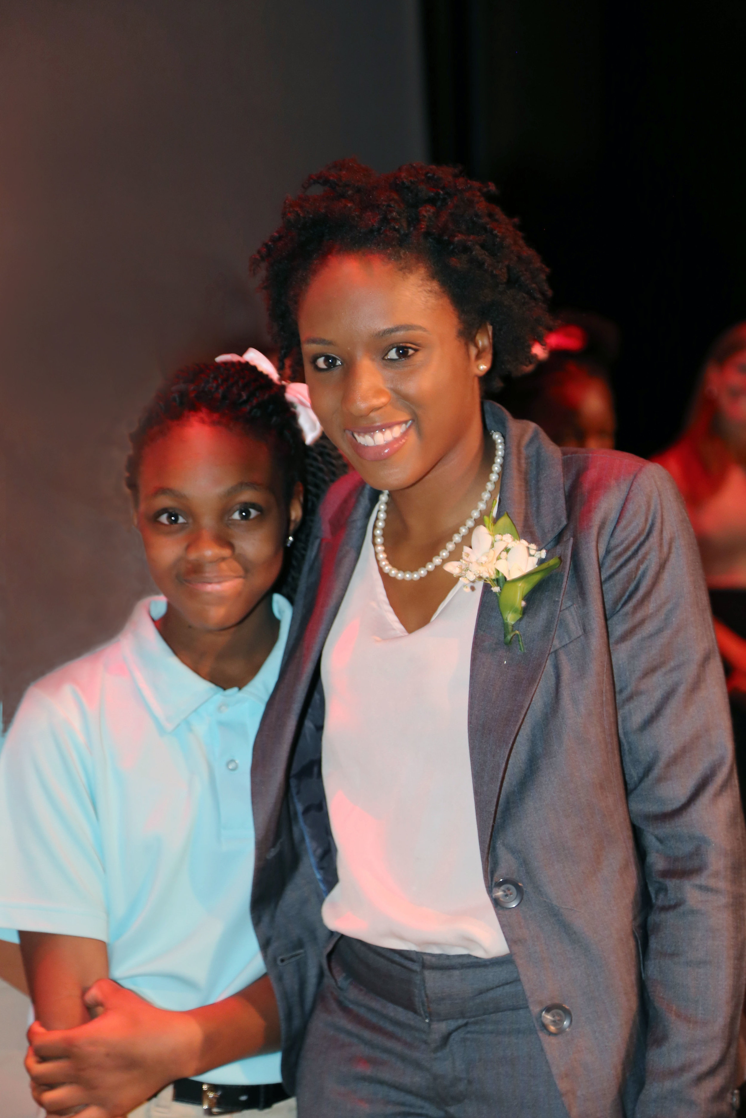 LaDonna, SEED DC '12, Florida A&M University '16) pins SEED Miami sixth grader N'stari during her Dream Ceremony.