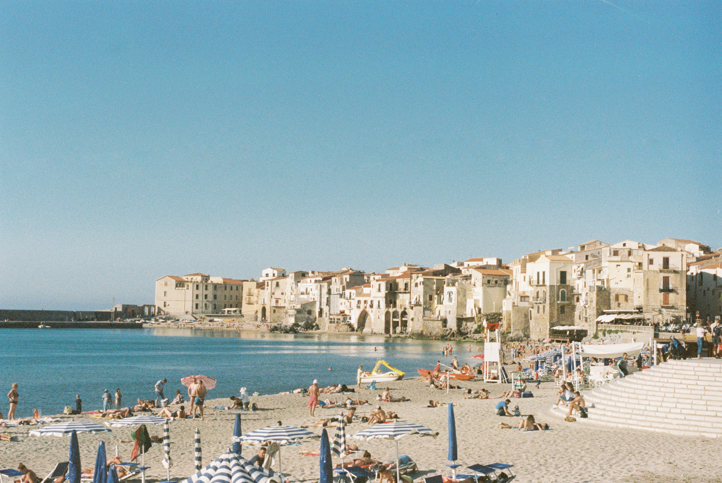 summer vacation by the sea in cefalu, sicily