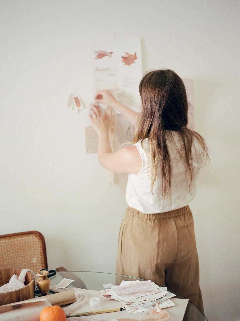 Woman creating a mood board
