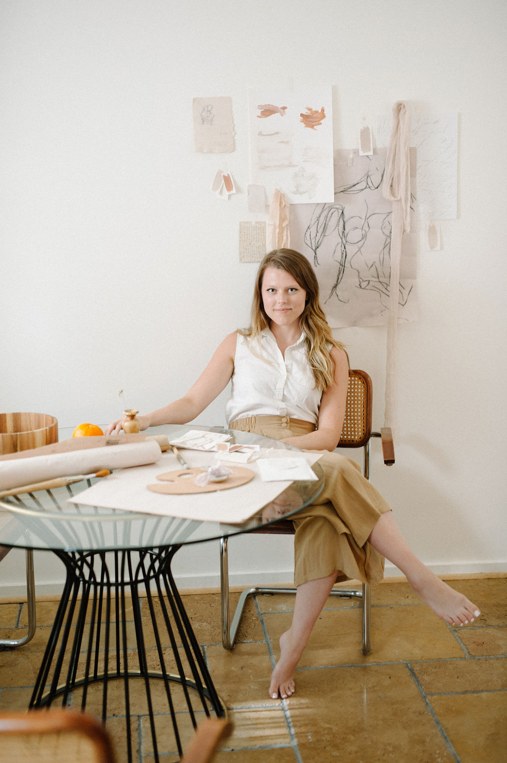 Woman sitting at a table creating a brand strategy